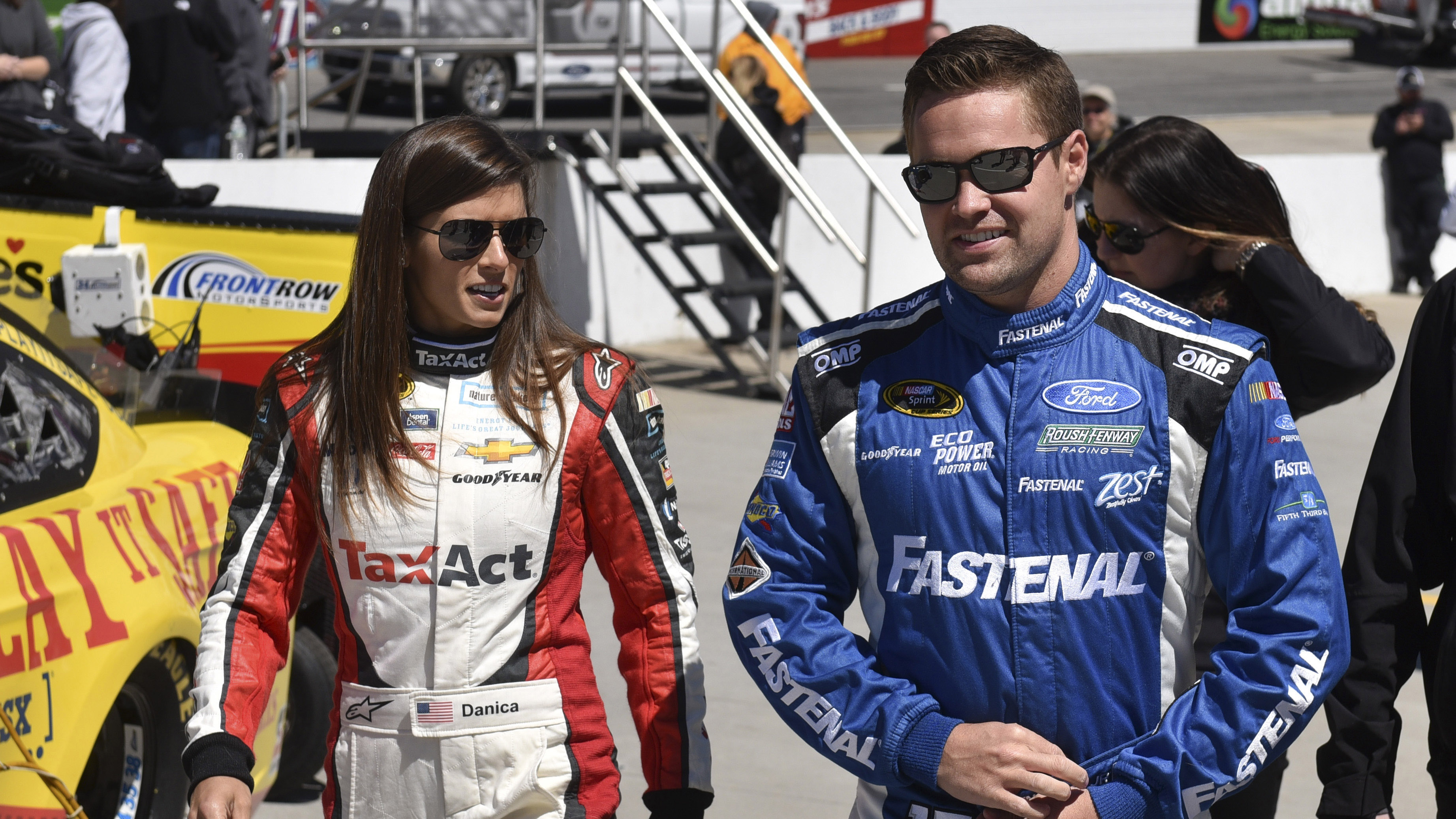 Apr 2, 2016; Martinsville, VA, USA; NASCAR Sprint Cup Series driver Danica Patrick (10) and driver Ricky Stenhouse Jr. (17) arrive prior the Alpha Energy Solutions 250 at Martinsville Speedway. Mandatory Credit: Michael Shroyer-USA TODAY Sports
