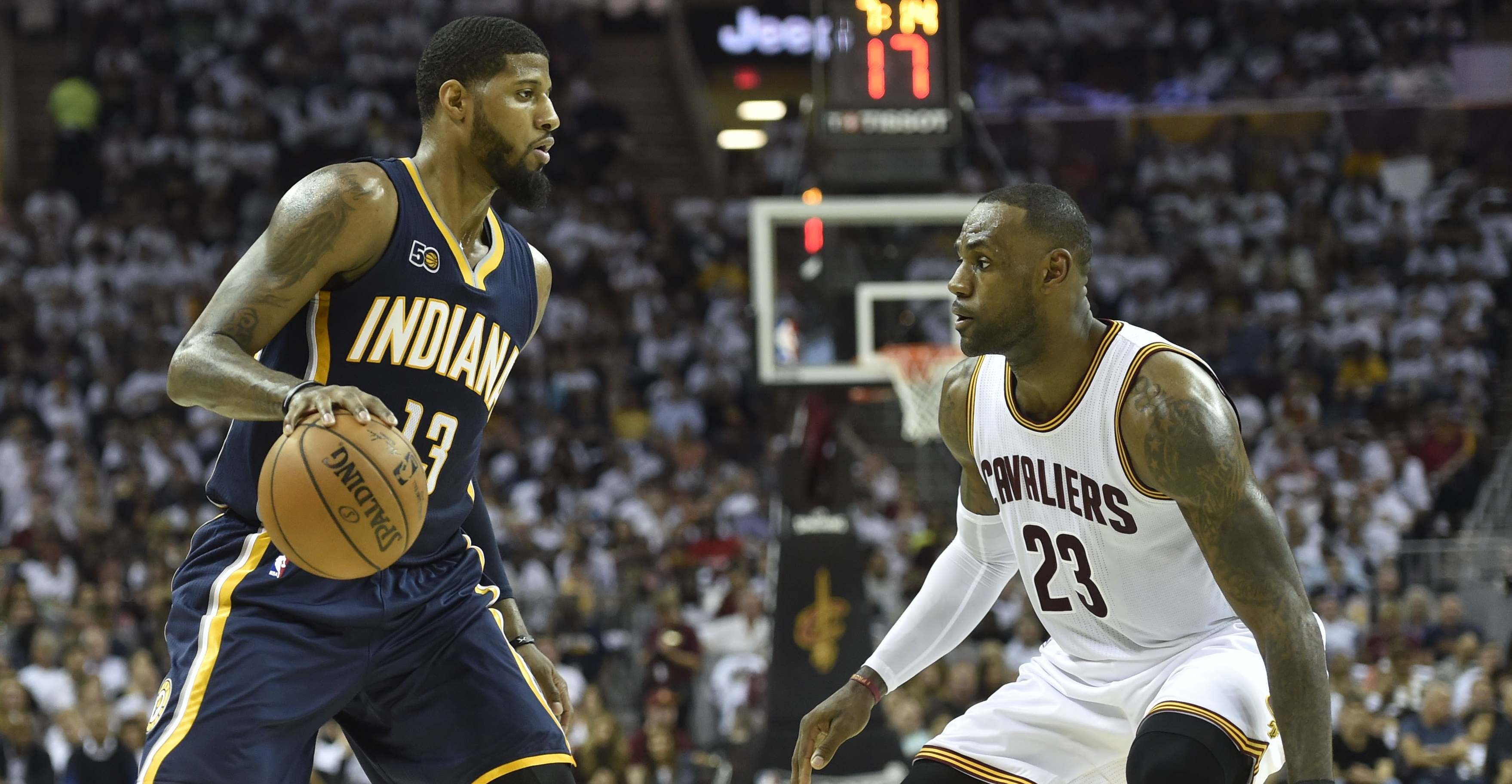 Apr 15, 2017; Cleveland, OH, USA; Indiana Pacers forward Paul George (13) dribbles against Cleveland Cavaliers forward LeBron James (23) in the second quarter in game one of the first round of the 2017 NBA Playoffs at Quicken Loans Arena. Mandatory Credit: David Richard-USA TODAY Sports
