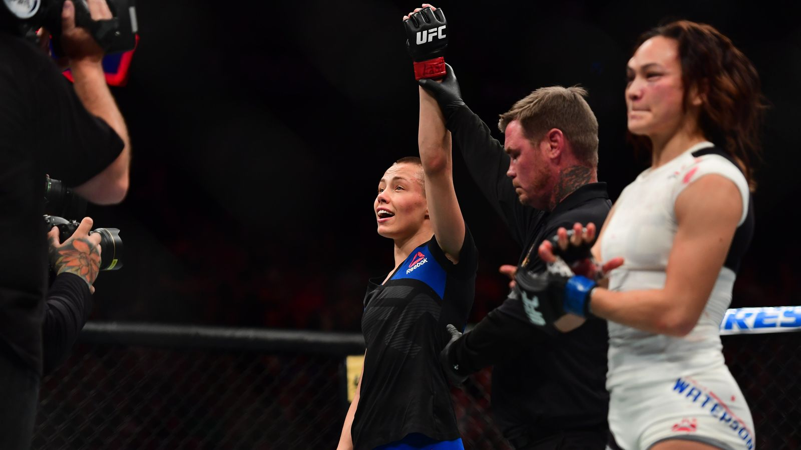 Apr 15, 2017; Kansas City, MO, USA; Rose Namajunas (Red Gloves) react to fight against Michelle Waterson (Blue Gloves) during UFC Fight Night at the Sprint Center. Mandatory Credit: Ron Chenoy-USA TODAY Sports