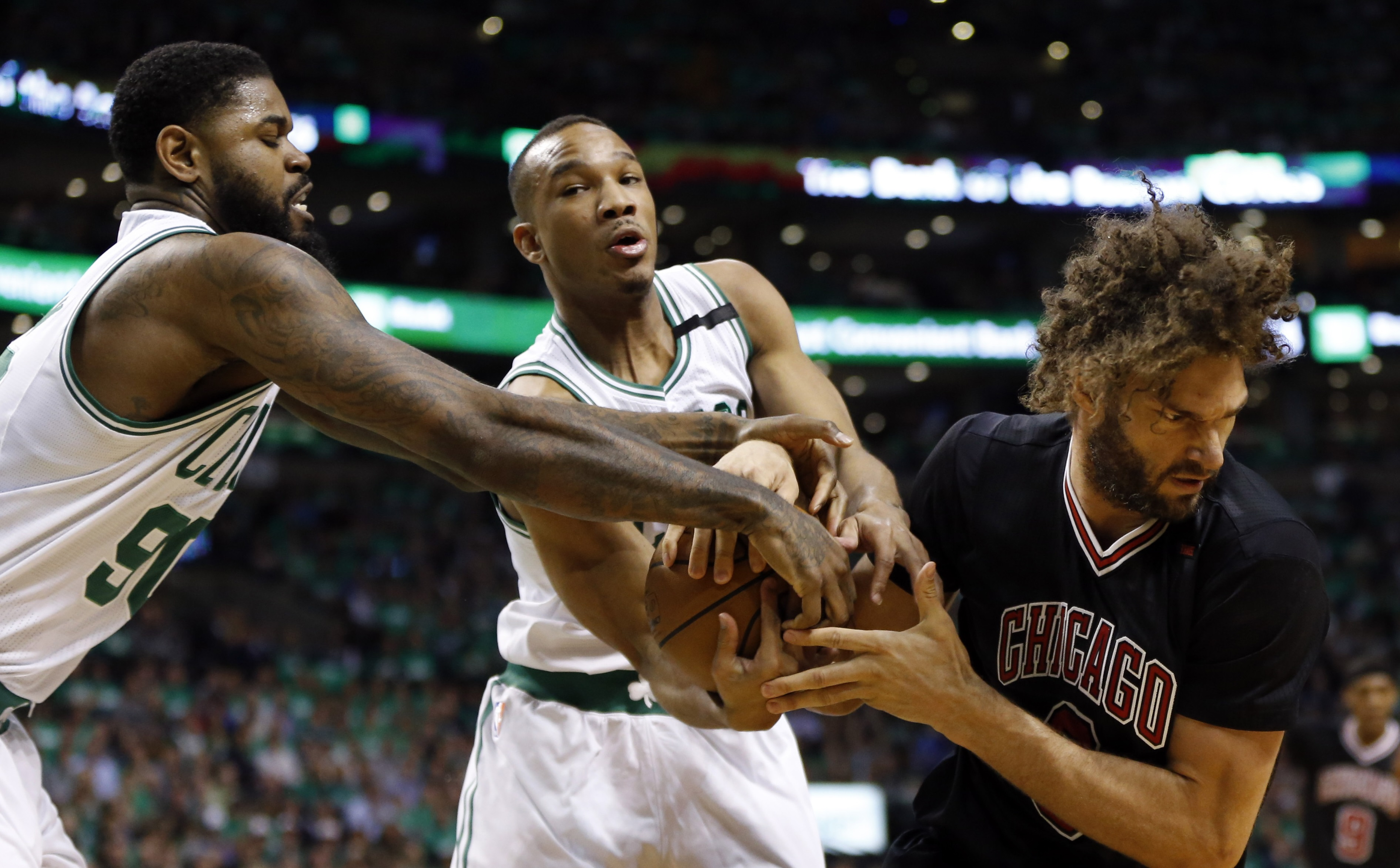 Apr 18, 2017; Boston, MA, USA; Boston Celtics guard Avery Bradley (0) and Boston Celtics center Amir Johnson (90) battle with Chicago Bulls center Robin Lopez (8) during the first quarter in game two of the first round of the 2017 NBA Playoffs at TD Garden. Mandatory Credit: Greg M. Cooper-USA TODAY Sports