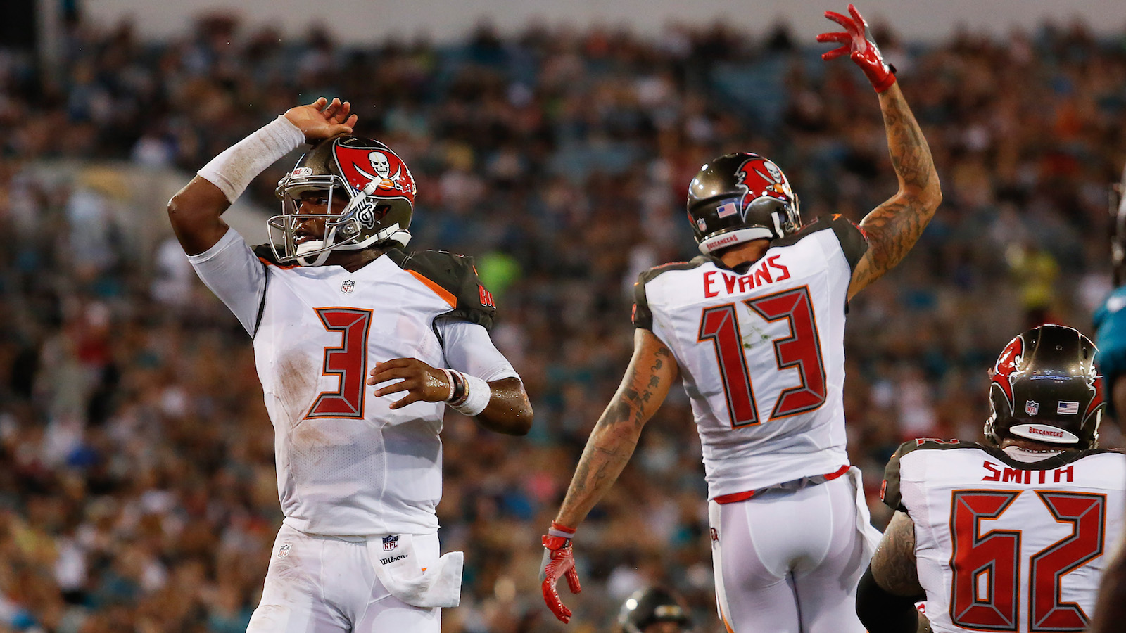 Aug 20, 2016; Jacksonville, FL, USA;  Tampa Bay Buccaneers quarterback Jameis Winston (3) and wide receiver Mike Evans (13) celebrate after a touchdown in the second quarter against the Jacksonville Jaguars at EverBank Field. Mandatory Credit: Logan Bowles-USA TODAY Sports