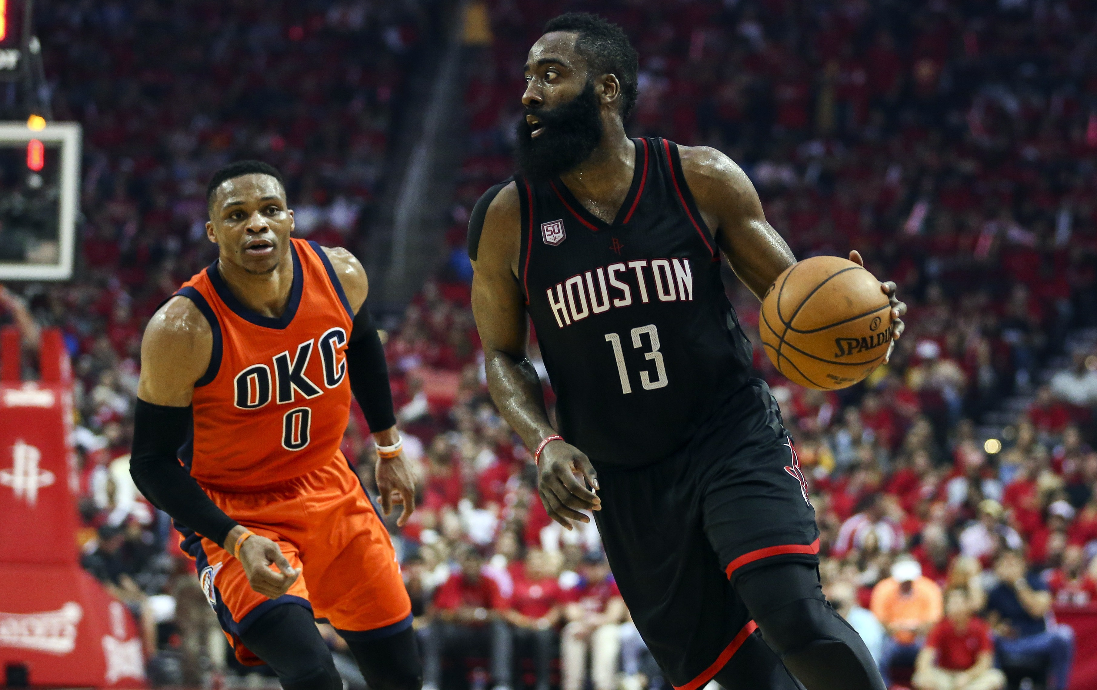 Apr 16, 2017; Houston, TX, USA; Houston Rockets guard James Harden (13) dribbles the ball during the third quarter as Oklahoma City Thunder guard Russell Westbrook (0) defends in game one of the first round of the 2017 NBA Playoffs at Toyota Center. Mandatory Credit: Troy Taormina-USA TODAY Sports