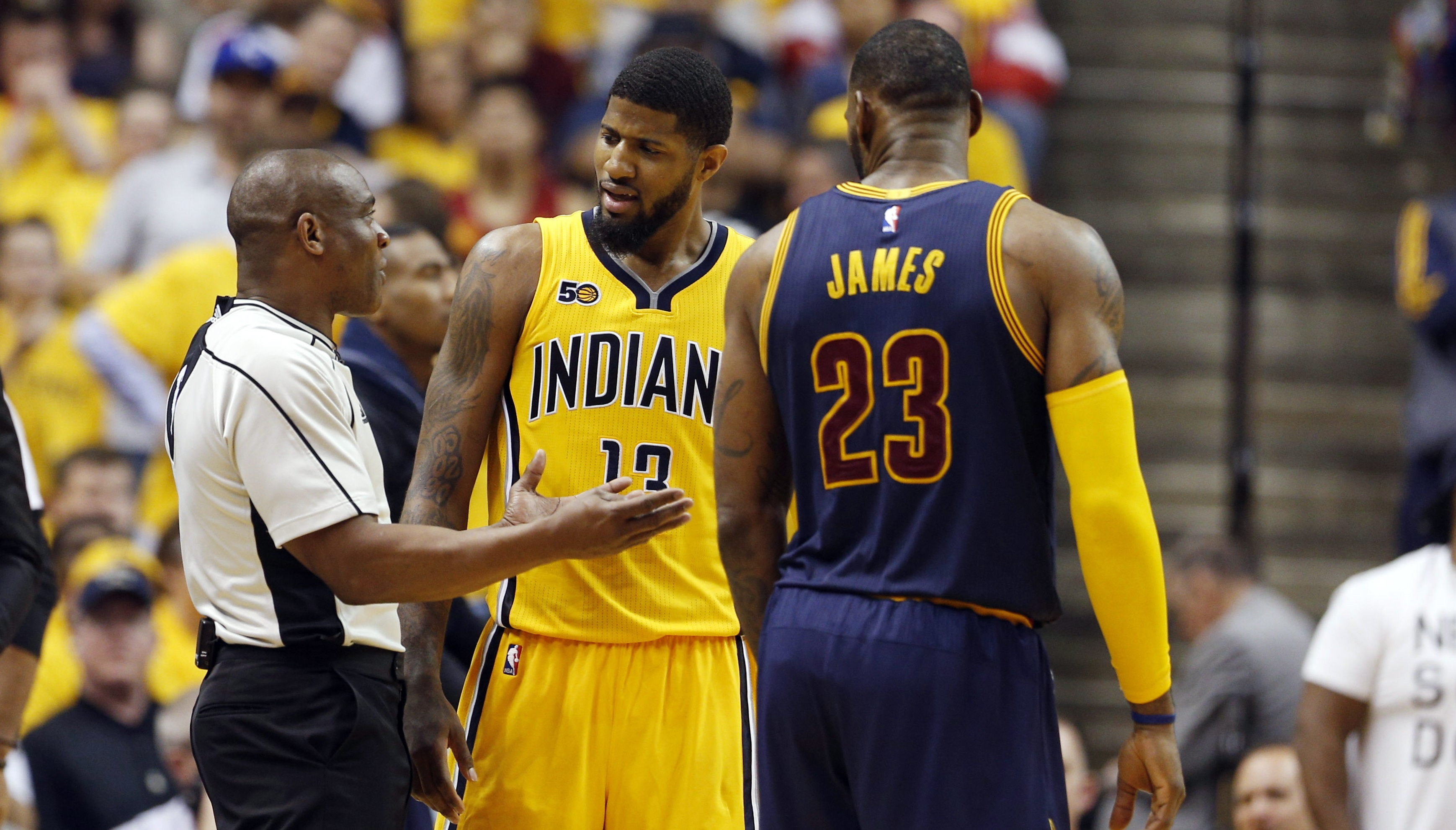 Apr 20, 2017; Indianapolis, IN, USA; Indiana Pacers forward Paul George (13) talks to a referee against Cleveland Cavaliers while Cleveland Cavaliers forward LeBron James (23) listens in during game three of the first round of the 2017 NBA Playoffs at Bankers Life Fieldhouse. Cleveland defeats Indiana 119-114. Mandatory Credit: Brian Spurlock-USA TODAY Sports