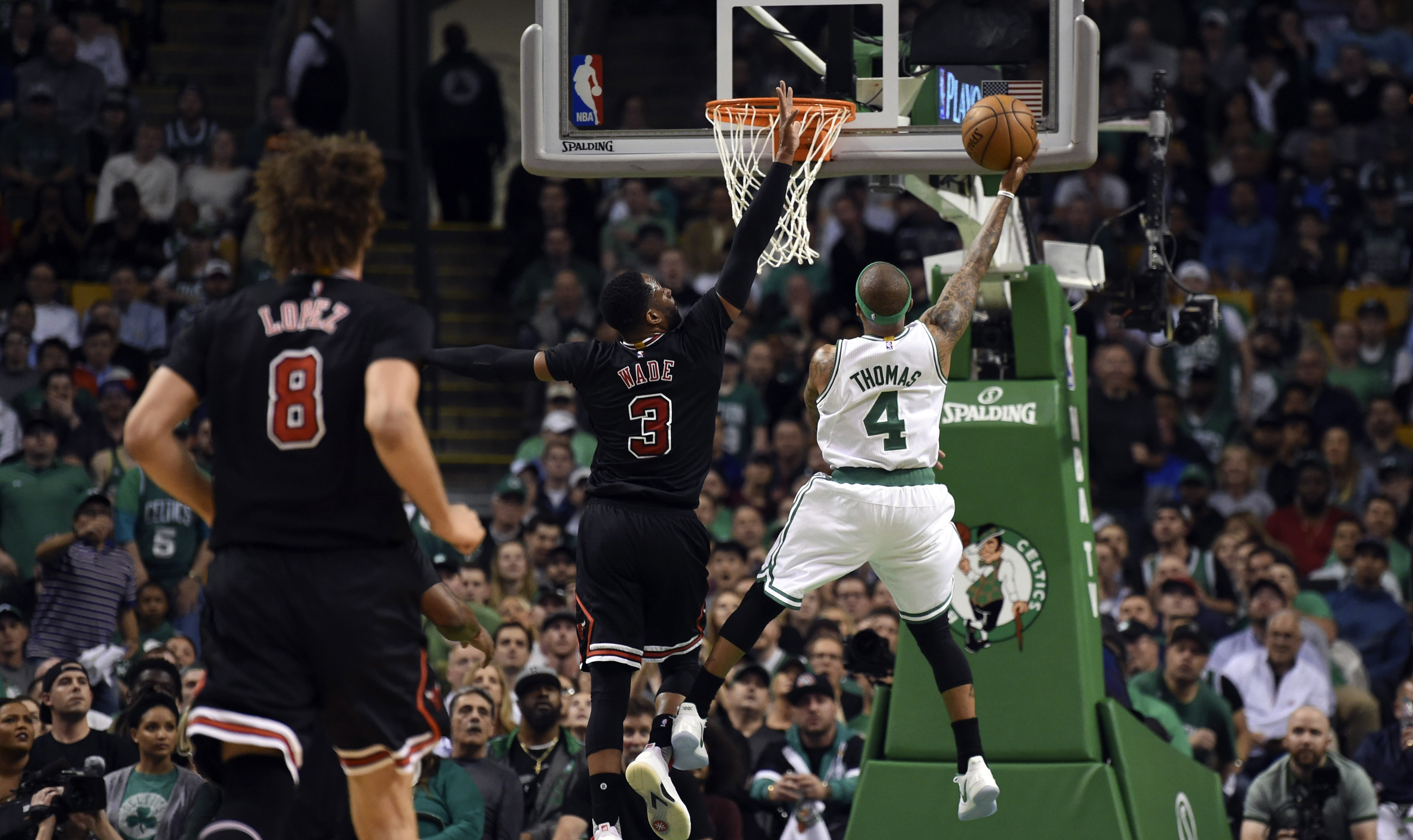 Apr 26, 2017; Boston, MA, USA; Boston Celtics guard Isaiah Thomas (4) lays the ball over the reach of Chicago Bulls guard Dwyane Wade (3) during the first half in game five of the first round of the 2017 NBA Playoffs at TD Garden. Mandatory Credit: Bob DeChiara-USA TODAY Sports