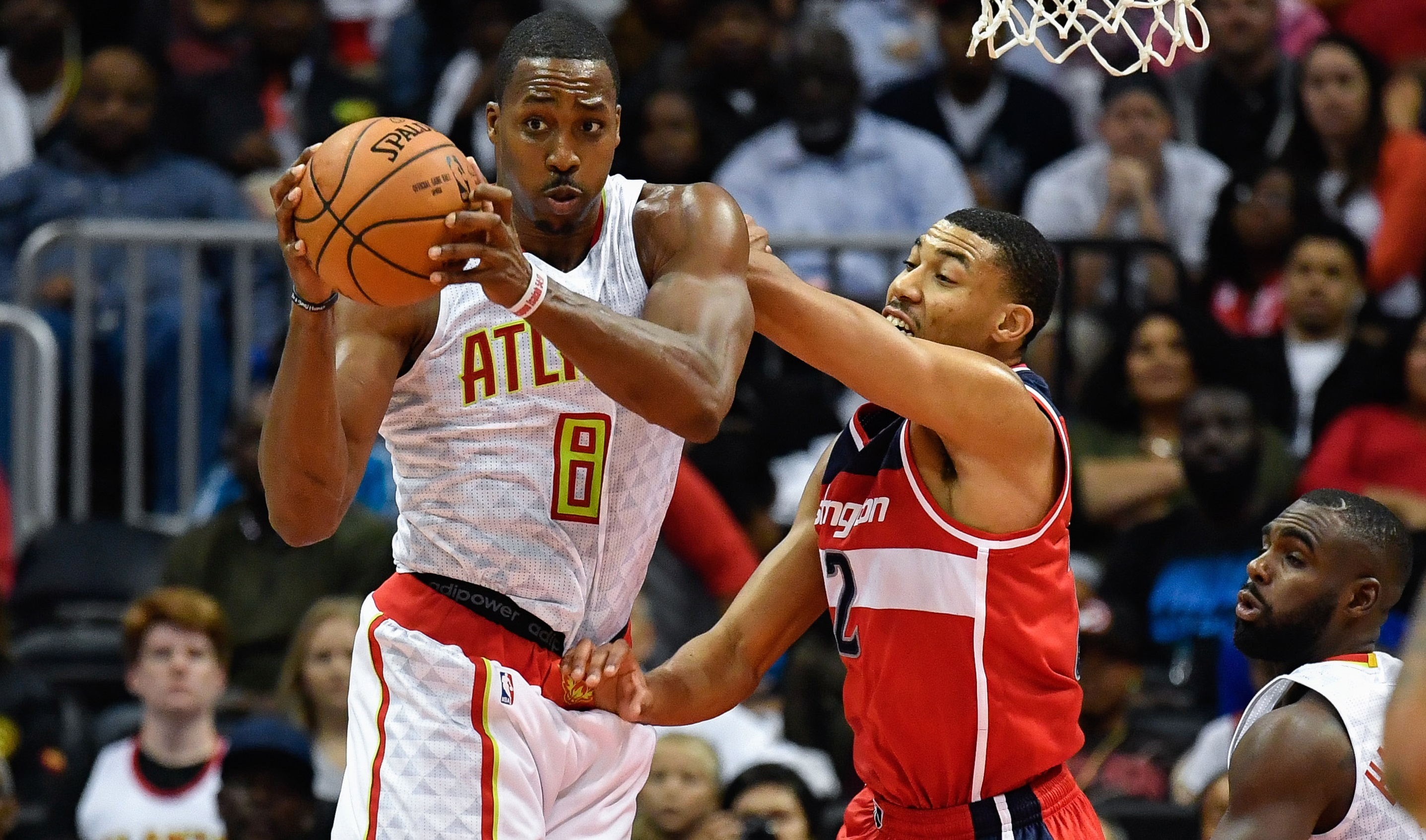 Oct 27, 2016; Atlanta, GA, USA; Atlanta Hawks center Dwight Howard (8) controls a rebound defended by Washington Wizards guard John Wall (2) during the second half at Philips Arena. The Hawks defeated the Wizards 114-99. Mandatory Credit: Dale Zanine-USA TODAY Sports