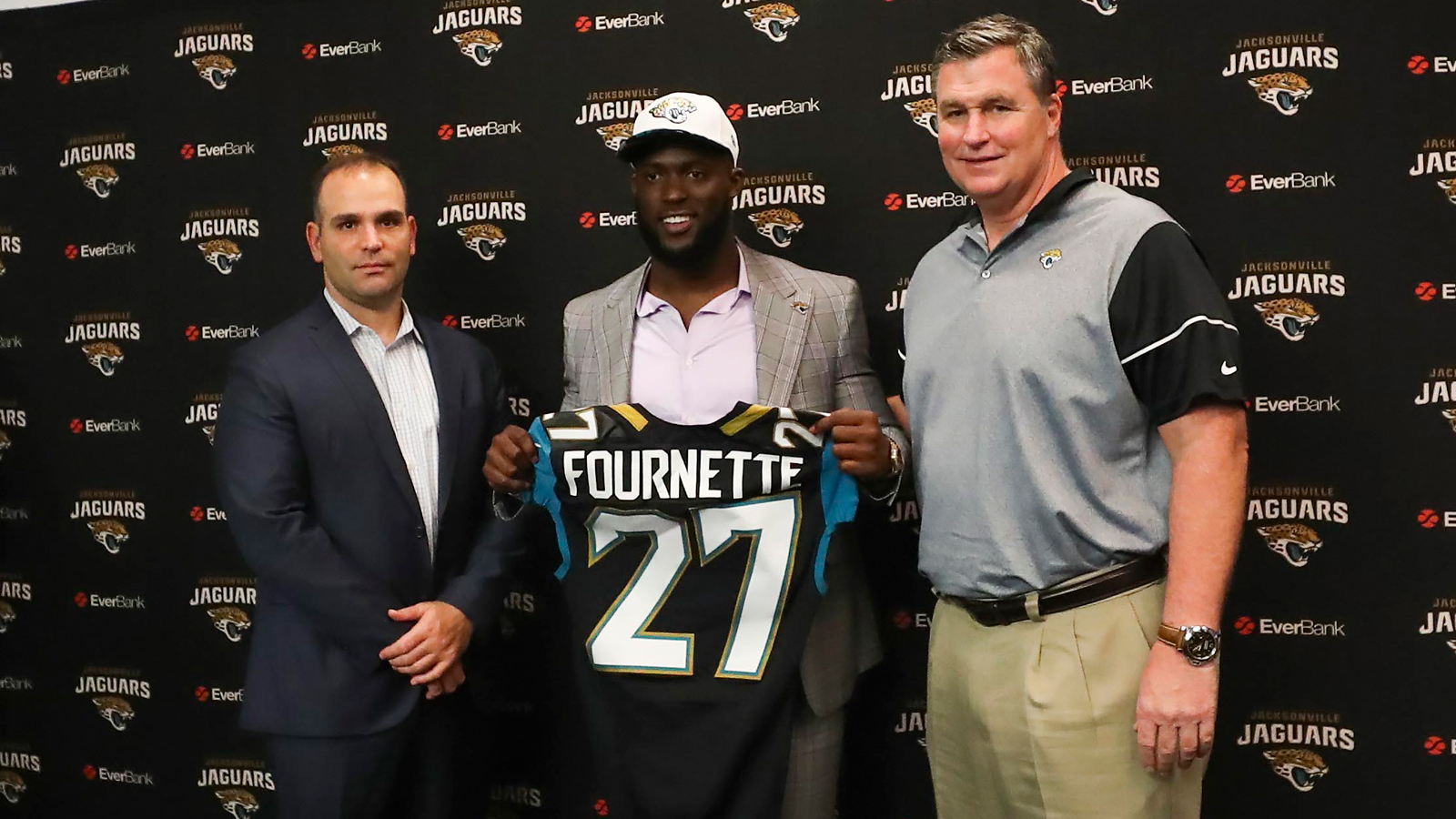Apr 28, 2017; Jacksonville, FL, USA; Jacksonville Jaguars general manager Dave Caldwell (left), running back Leonard Fournette (center) and head coach Doug Marrone (right) pose for a picture during a press conference at EverBank Field.Leonard Fournette was the 2017 first round pick of the Jacksonville Jaguars.  Mandatory Credit: Logan Bowles-USA TODAY Sports