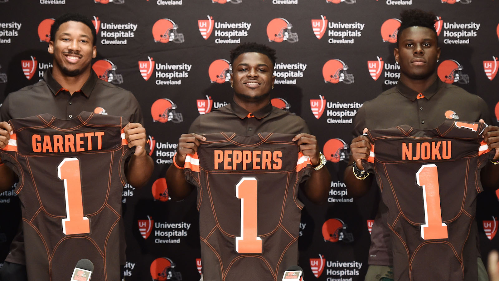 Apr 28, 2017; Berea, OH, USA; Cleveland Browns first round picks defensive lineman Myles Garrett and defensive back Jabrill Peppers and tight end David Njoku display their jerseys to the media at the Cleveland Browns training facility. Mandatory Credit: Ken Blaze-USA TODAY Sports