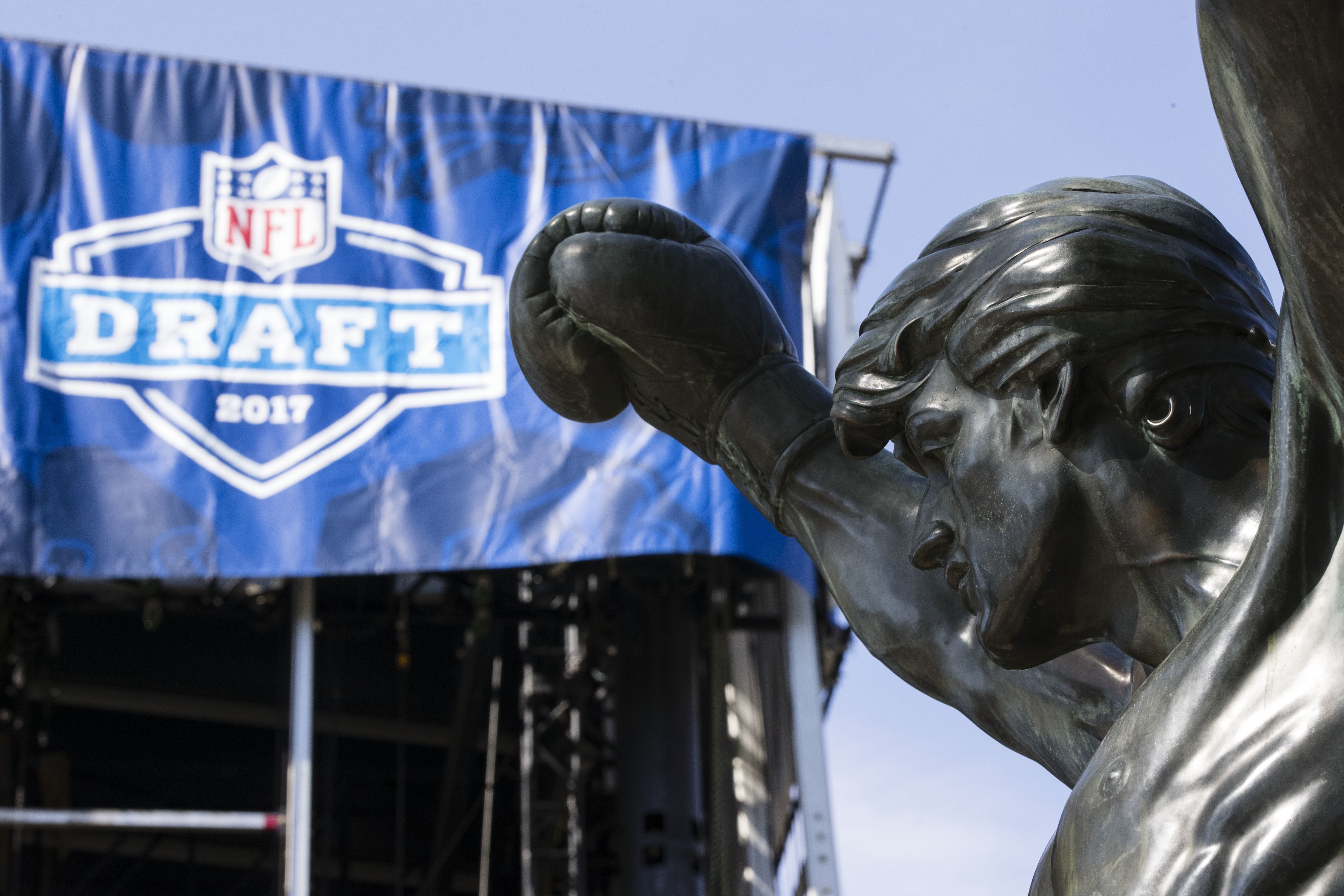 The Rocky statue stands in view of the stage being constructed for the upcoming 2017 NFL football draft on the steps of the Philadelphia Museum of Art in Philadelphia, Tuesday, April 18, 2017. When the NFL chose Philadelphia to host the 2017 draft, they insisted on holding the three-day event at the Art Museum in front of the iconic Rocky steps. Mayor Jim Kenney and city officials made it happen so construction crews are putting together a 3,000-seat theater for an extravaganza that's expected to draw about 200,000 people to the venue. (AP Photo/Matt Rourke)