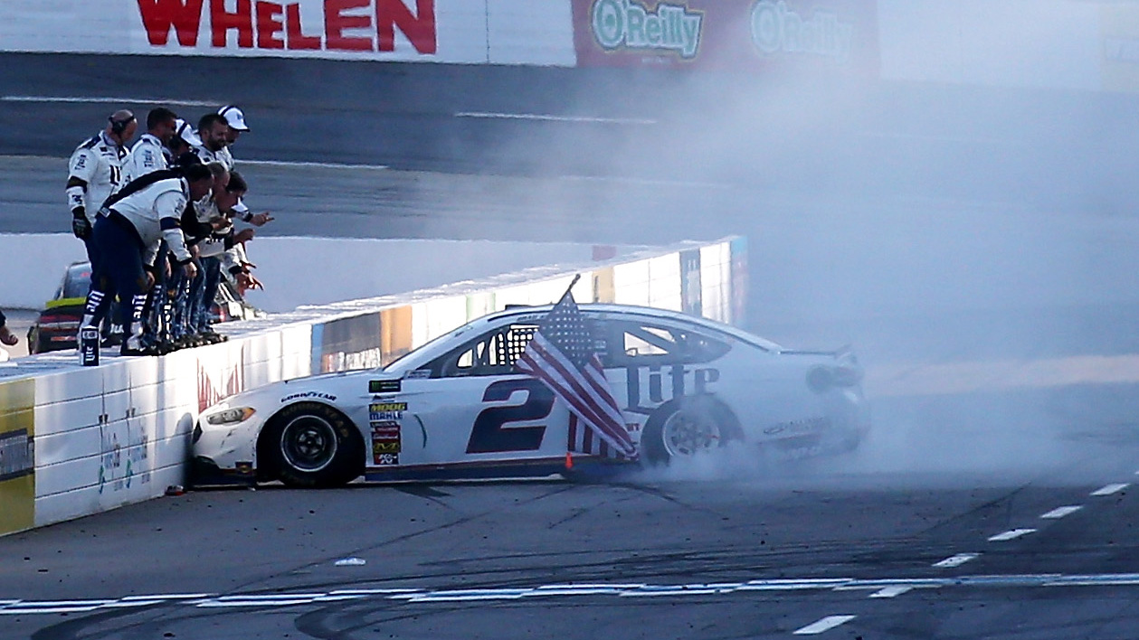 MARTINSVILLE, VA - APRIL 02:  Brad Keselowski, driver of the #2 Miller Lite Ford, celebrates after winning the Monster Energy NASCAR Cup Series STP 500 at Martinsville Speedway on April 2, 2017 in Martinsville, Virginia.  (Photo by Sarah Crabill/Getty Images)