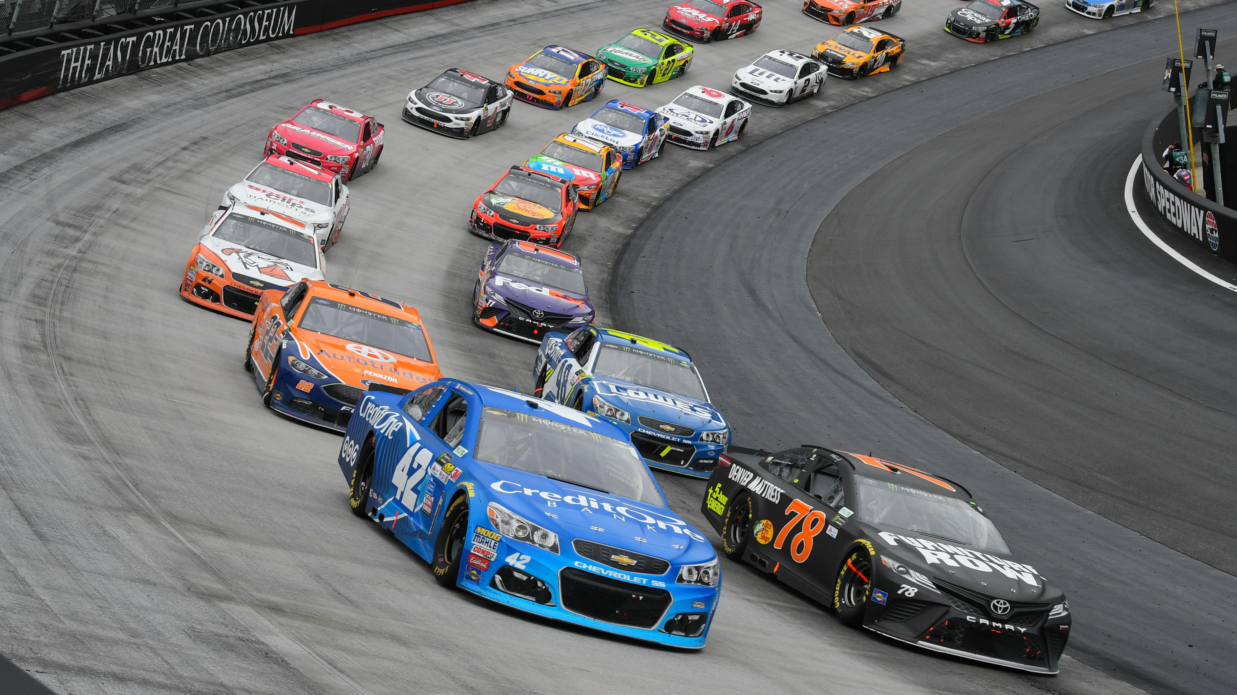 Apr 24, 2017; Bristol, TN, USA; NASCAR Cup Series drivers Kyle Larson (42) and Martin Truex Jr. (78) lead a restart during the Food City 500 at Bristol Motor Speedway. Mandatory Credit: Randy Sartin-USA TODAY Sports