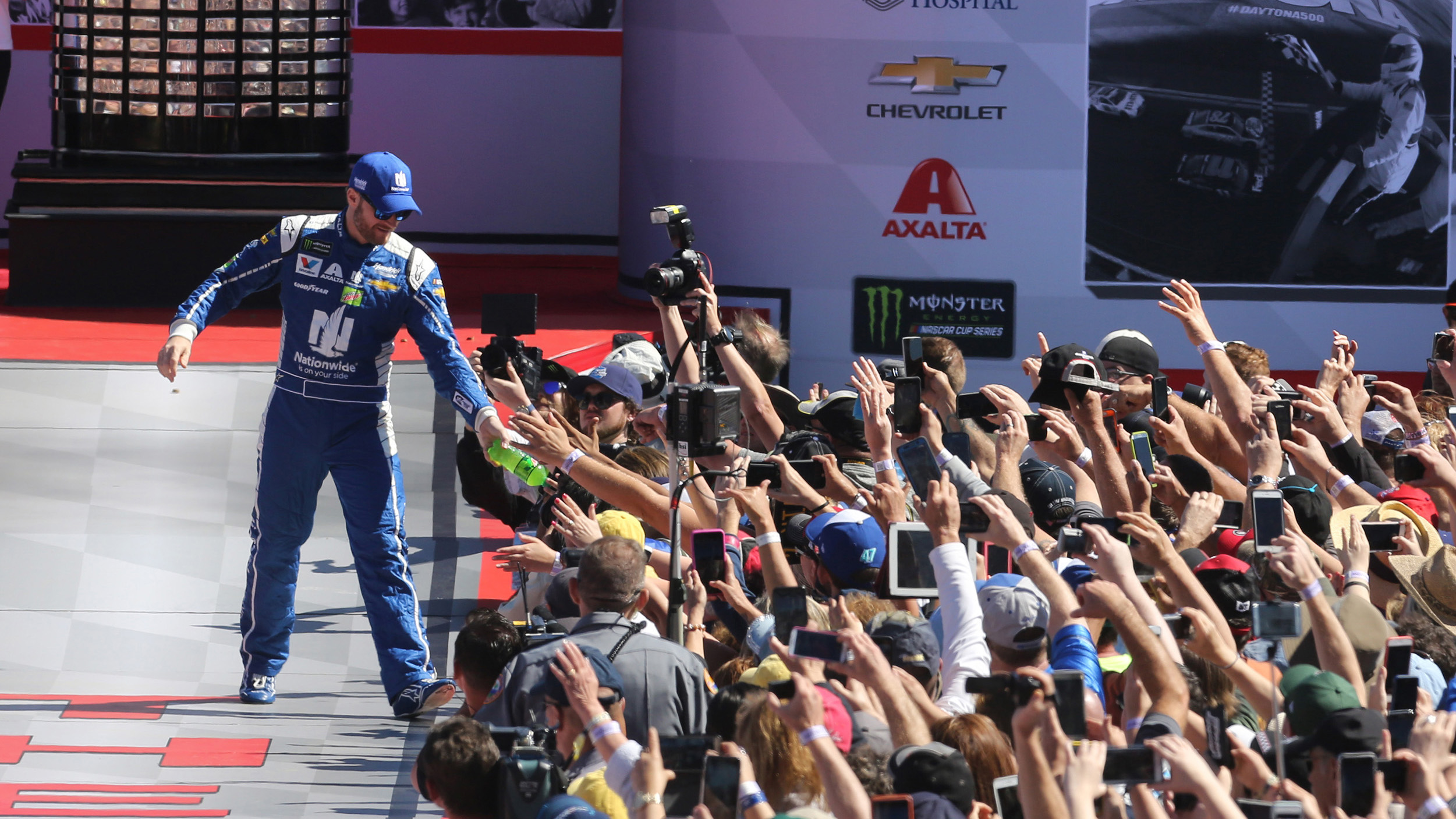 Dale Earnhardt Jr. hands off a bottle of soda to fans during driver introductions at the Daytona 500 on Sunday, Feb. 26, 2017 at Daytona International Speedway in Daytona Beach, Fla. (Joe Burbank/Orlando Sentinel/TNS via Getty Images)