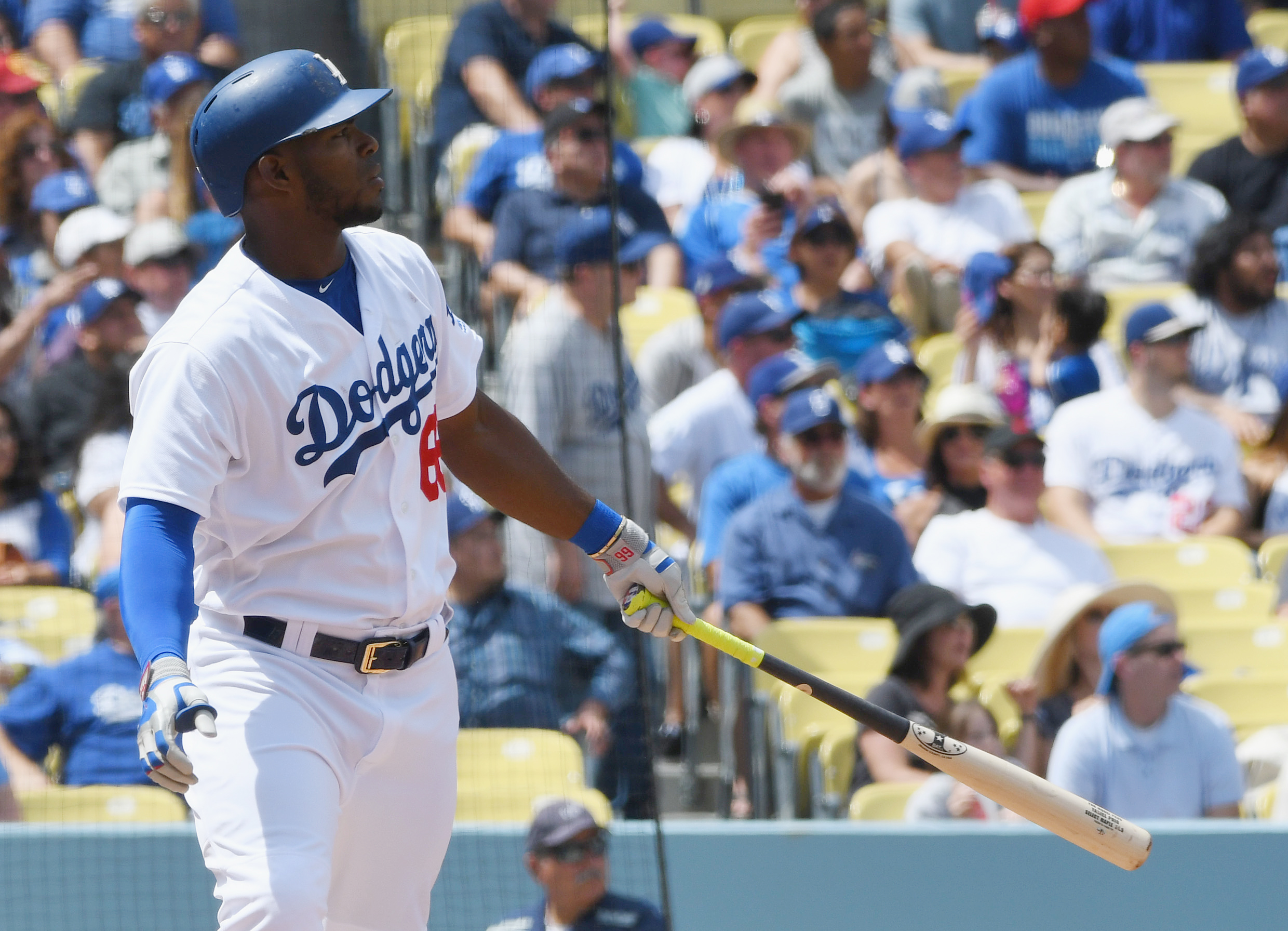 Apr 6, 2017; Los Angeles, CA, USA; Los Angeles Dodgers right fielder Yasiel Puig (66) hits his second two run home run of the game against the San Diego Padres in the fourth inning at Dodger Stadium. Mandatory Credit: Jayne Kamin-Oncea-USA TODAY Sports
