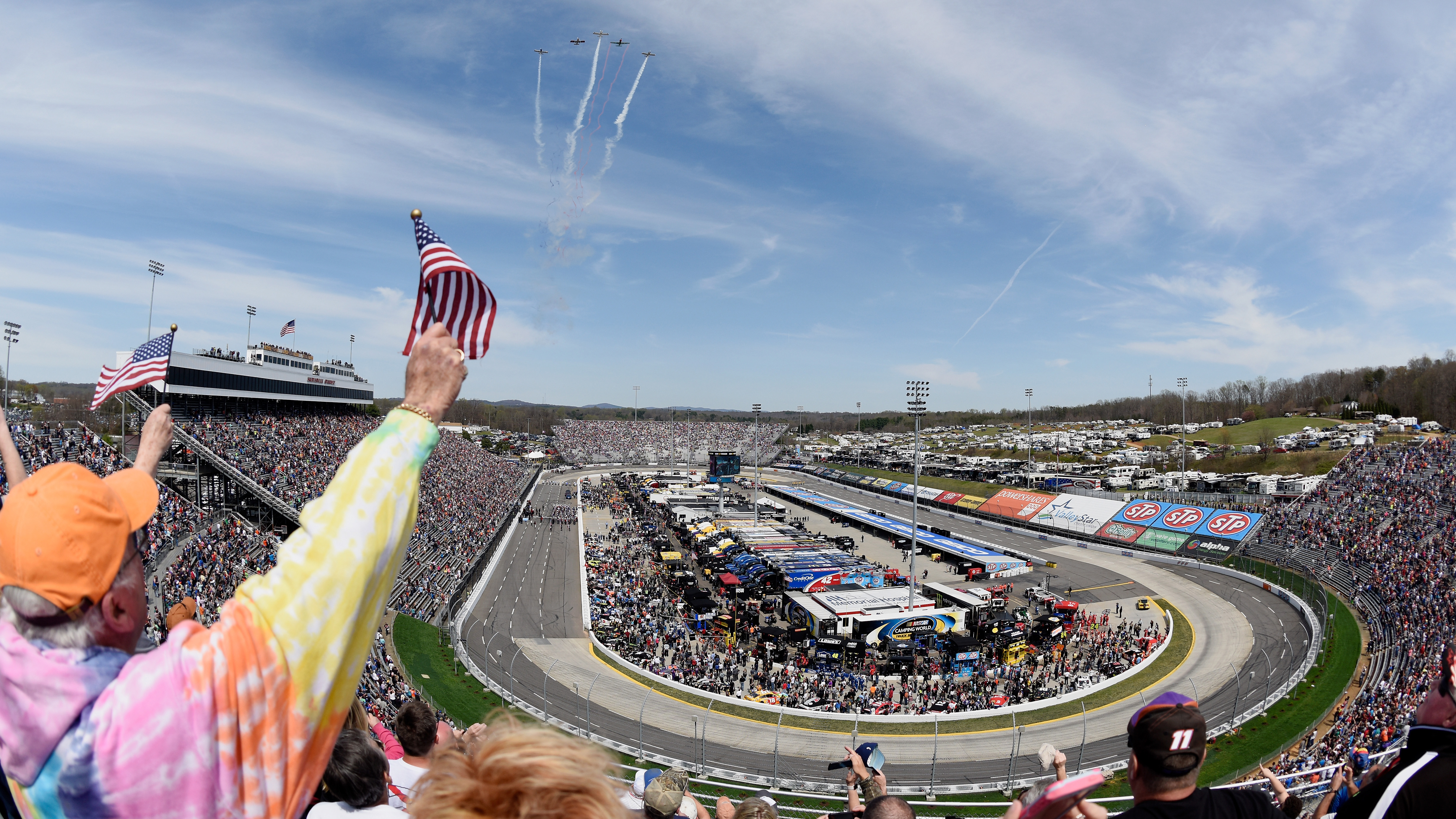 MARTINSVILLE, VA - APRIL 02:  Fans cheer during the flyover before the Monster Energy NASCAR Cup Series STP 500 at Martinsville Speedway on April 2, 2017 in Martinsville, Virginia.  (Photo by Jared C. Tilton/Getty Images)