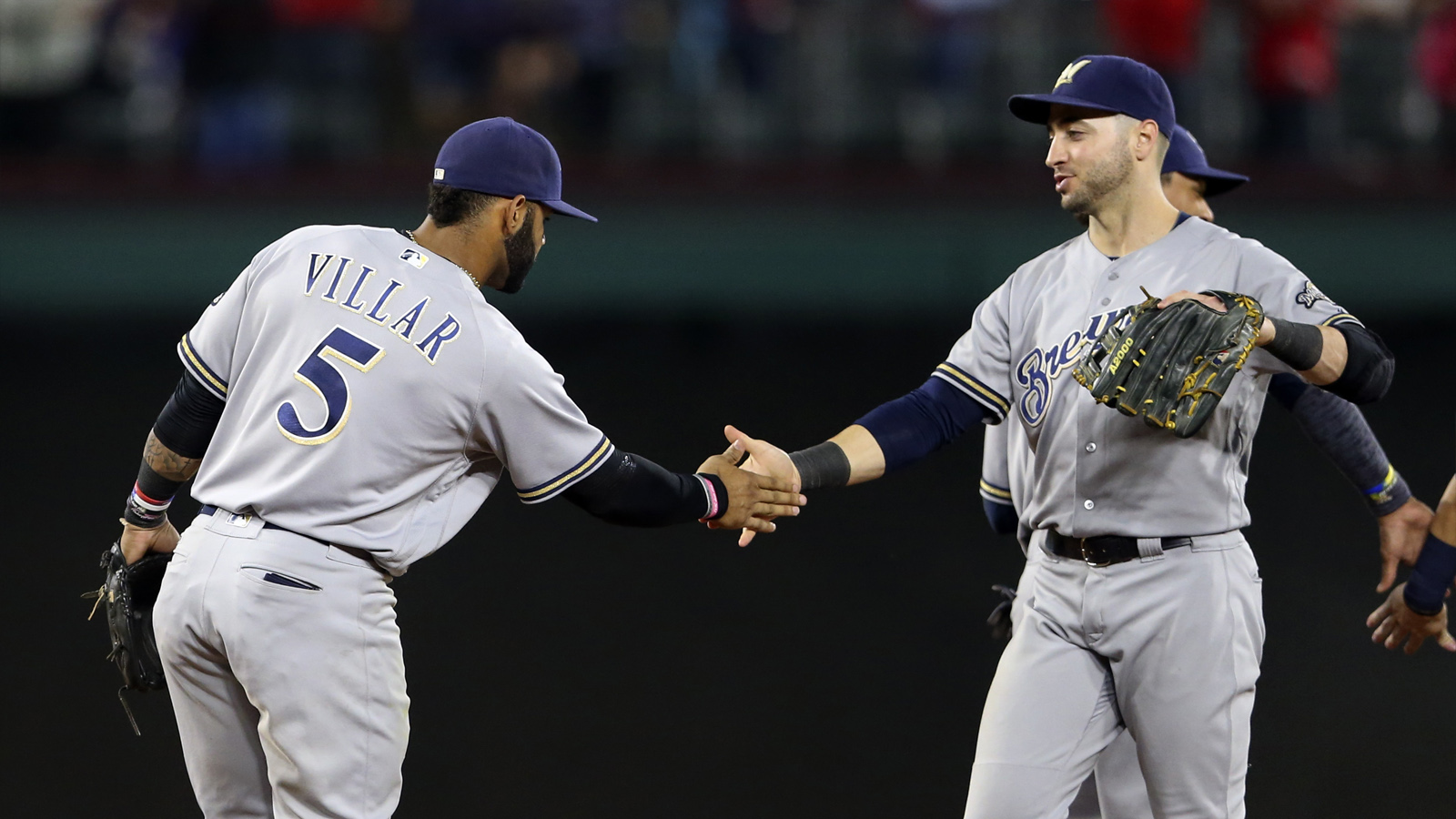 Sep 26, 2016; Arlington, TX, USA; Milwaukee Brewers second baseman Jonathan Villar (5) and left fielder Ryan Braun (8) celebrate after the game against the Texas Rangers at Globe Life Park in Arlington. Mandatory Credit: Kevin Jairaj-USA TODAY Sports