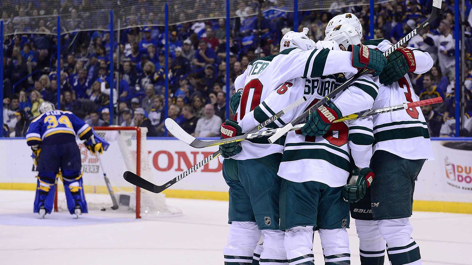 Apr 19, 2017; St. Louis, MO, USA; Minnesota Wild center Charlie Coyle (3) celebrates with teammates after scoring against St. Louis Blues goalie Jake Allen (34) during the first period in game four of the first round of the 2017 Stanley Cup Playoffs at Scottrade Center. Mandatory Credit: Jeff Curry-USA TODAY Sports