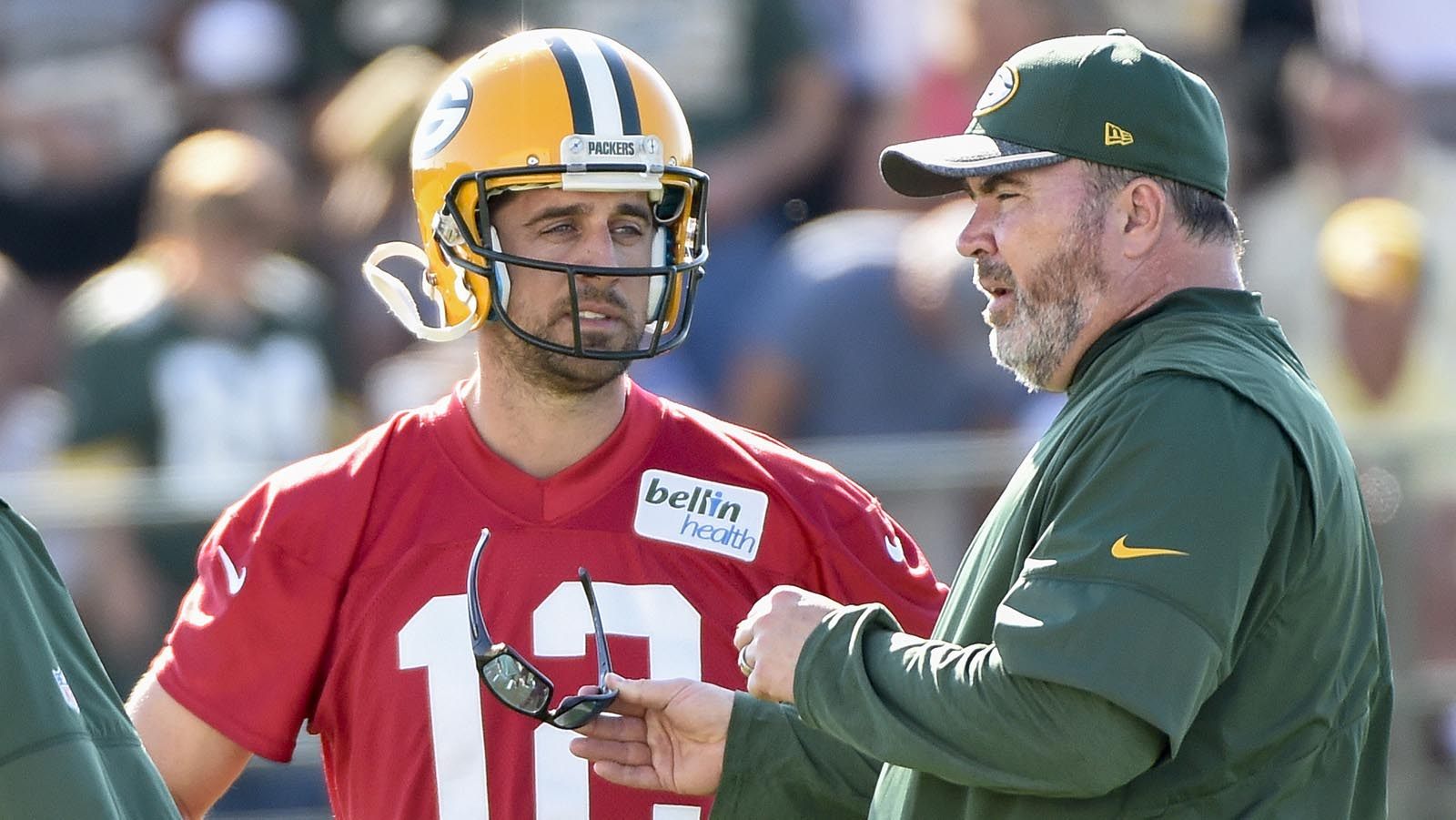 Jul 26, 2016; De Pere, WI, USA; Green Bay Packers quarterback Aaron Rodgers (12) talks to head coach Mike McCarthy (right) during training camp at Ray Nitschke Field. Mandatory Credit: Benny Sieu-USA TODAY Sports