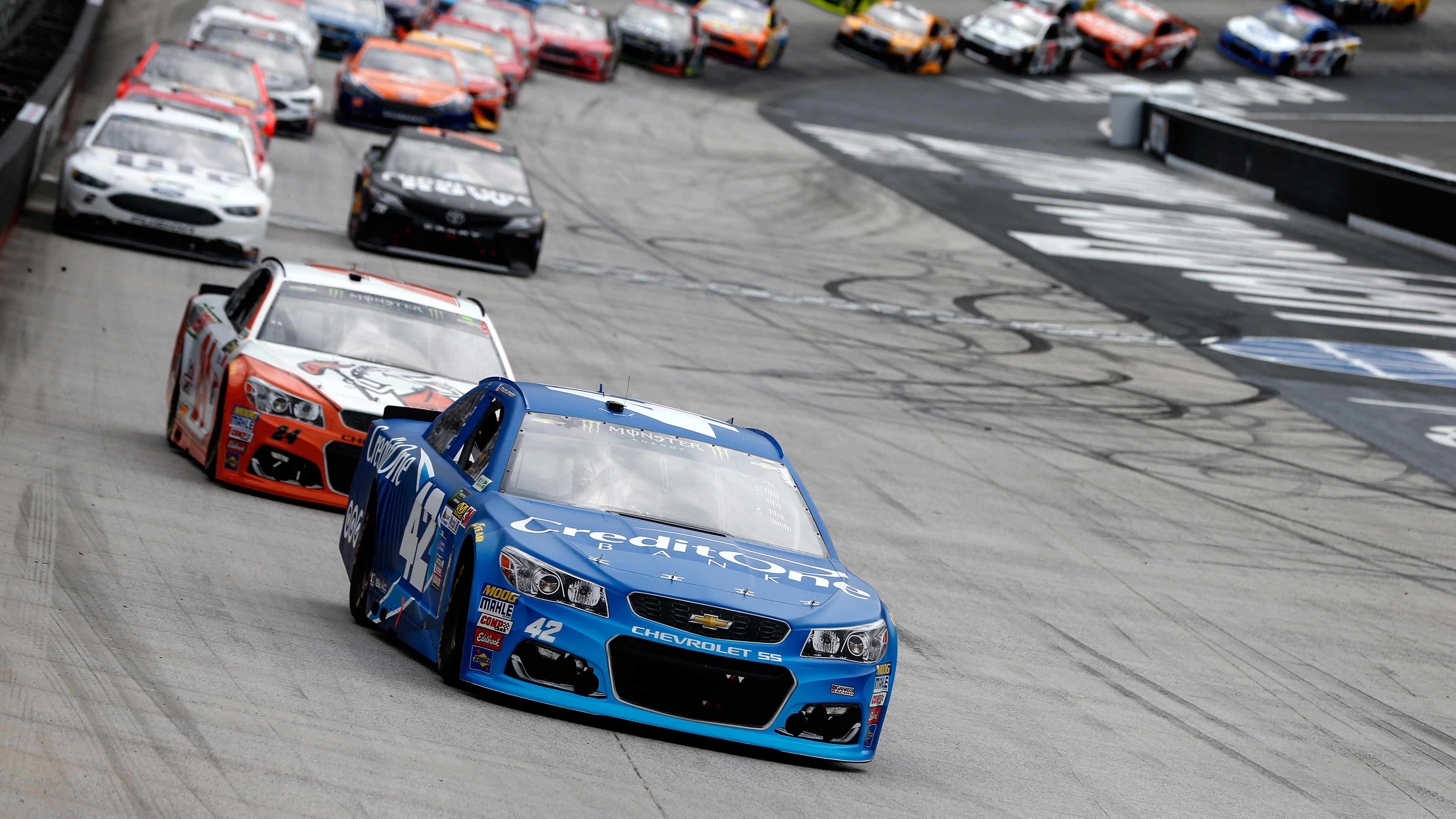 BRISTOL, TN - APRIL 24:  Kyle Larson, driver of the #42 Credit One Bank Chevrolet, leads a pack of cars during the Monster Energy NASCAR Cup Series Food City 500 at Bristol Motor Speedway on April 24, 2017 in Bristol, Tennessee.  (Photo by Brian Lawdermilk/Getty Images)
