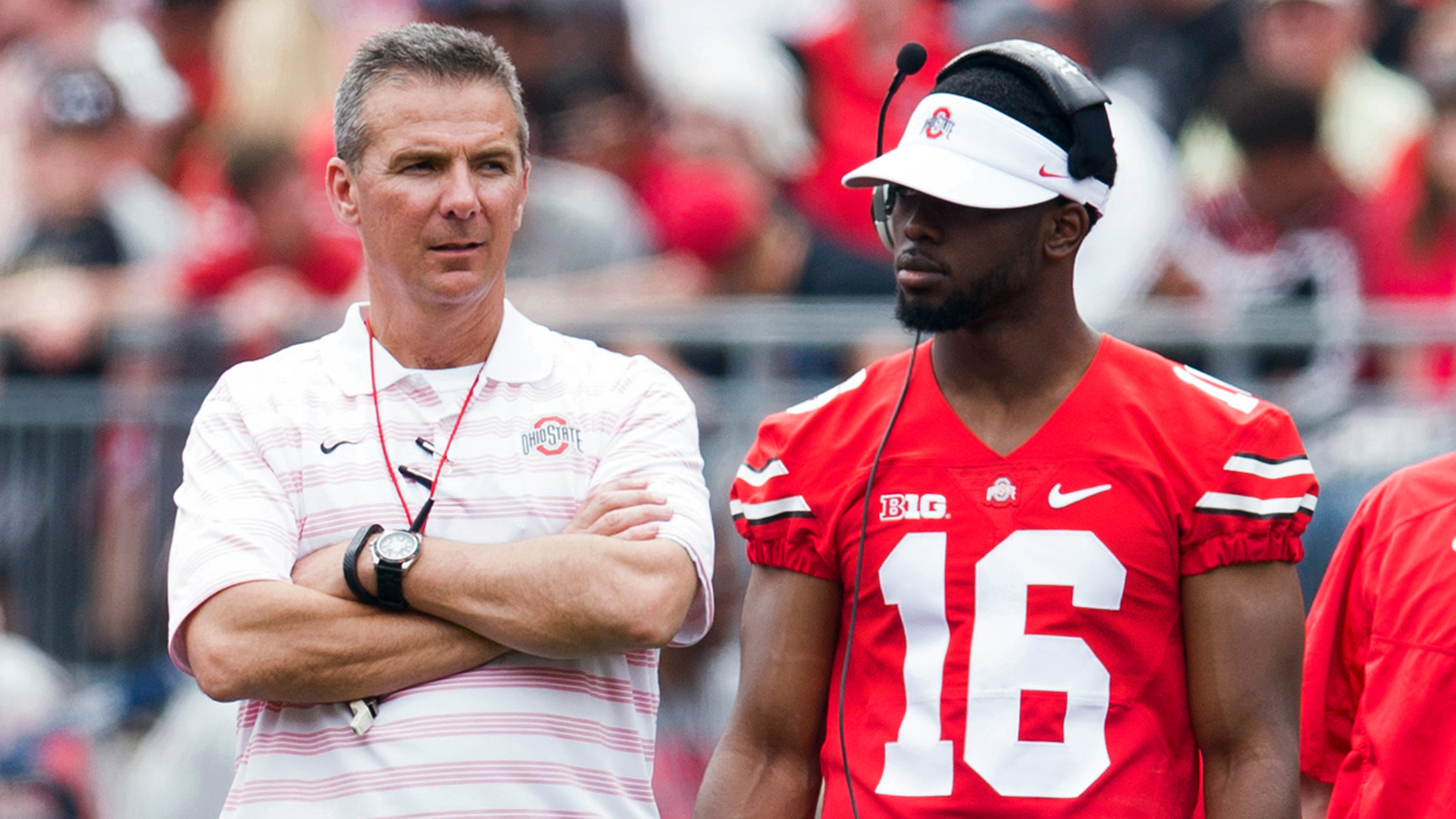 Apr 18, 2015; Columbus, OH, USA; Ohio State Buckeyes quarterback Braxton Miller (5) head coach Urban Meyer and quarterback J.T. Barrett (16) talk on the field during the Ohio State Spring Game at Ohio Stadium. The Gray team won the game 17-14. Mandatory Credit: Greg Bartram-USA TODAY Sports