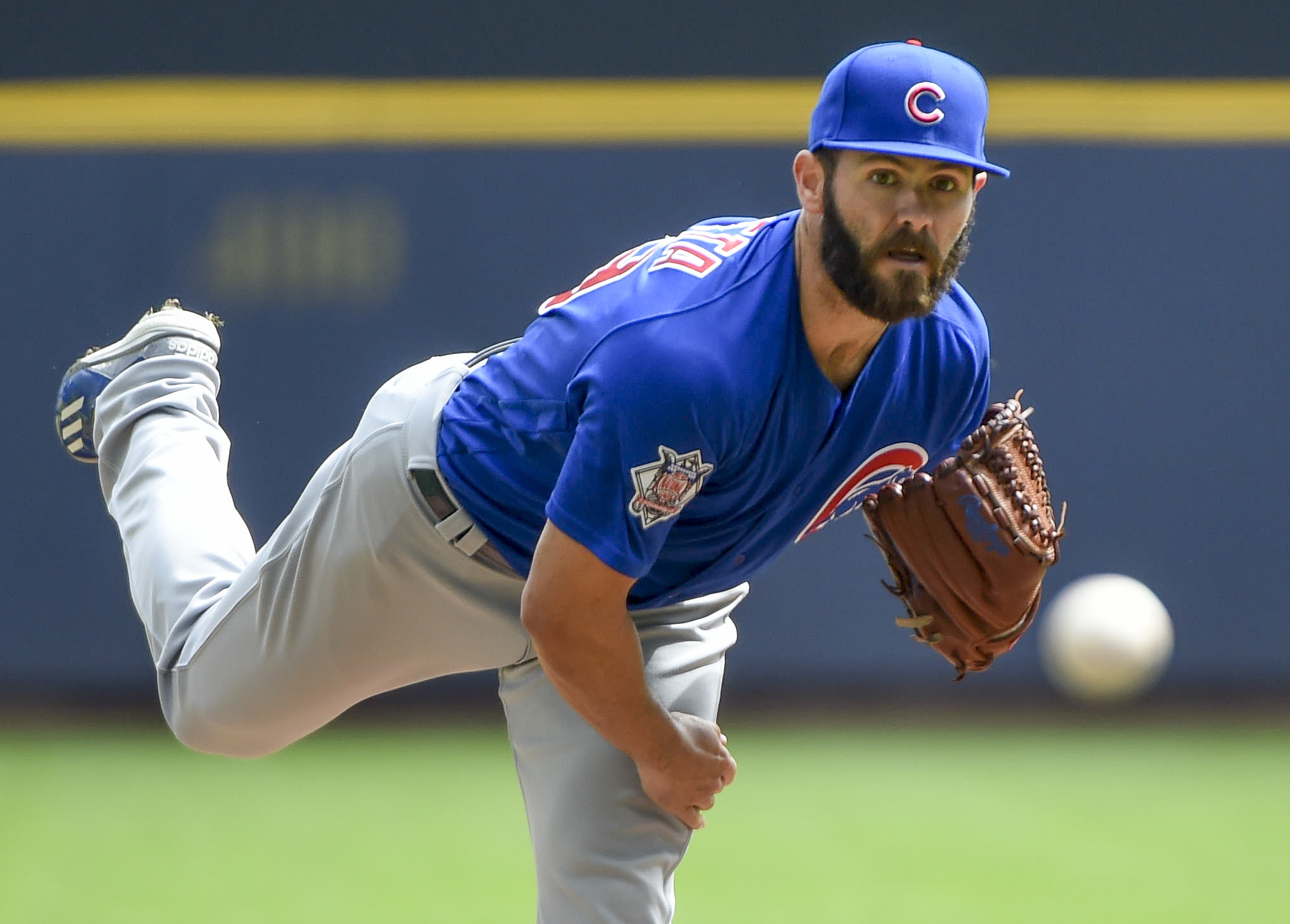 Apr 9, 2017; Milwaukee, WI, USA;  Chicago Cubs pitcher Jake Arrieta (49) pitches in the first inning against the Milwaukee Brewers at Miller Park. Mandatory Credit: Benny Sieu-USA TODAY Sports