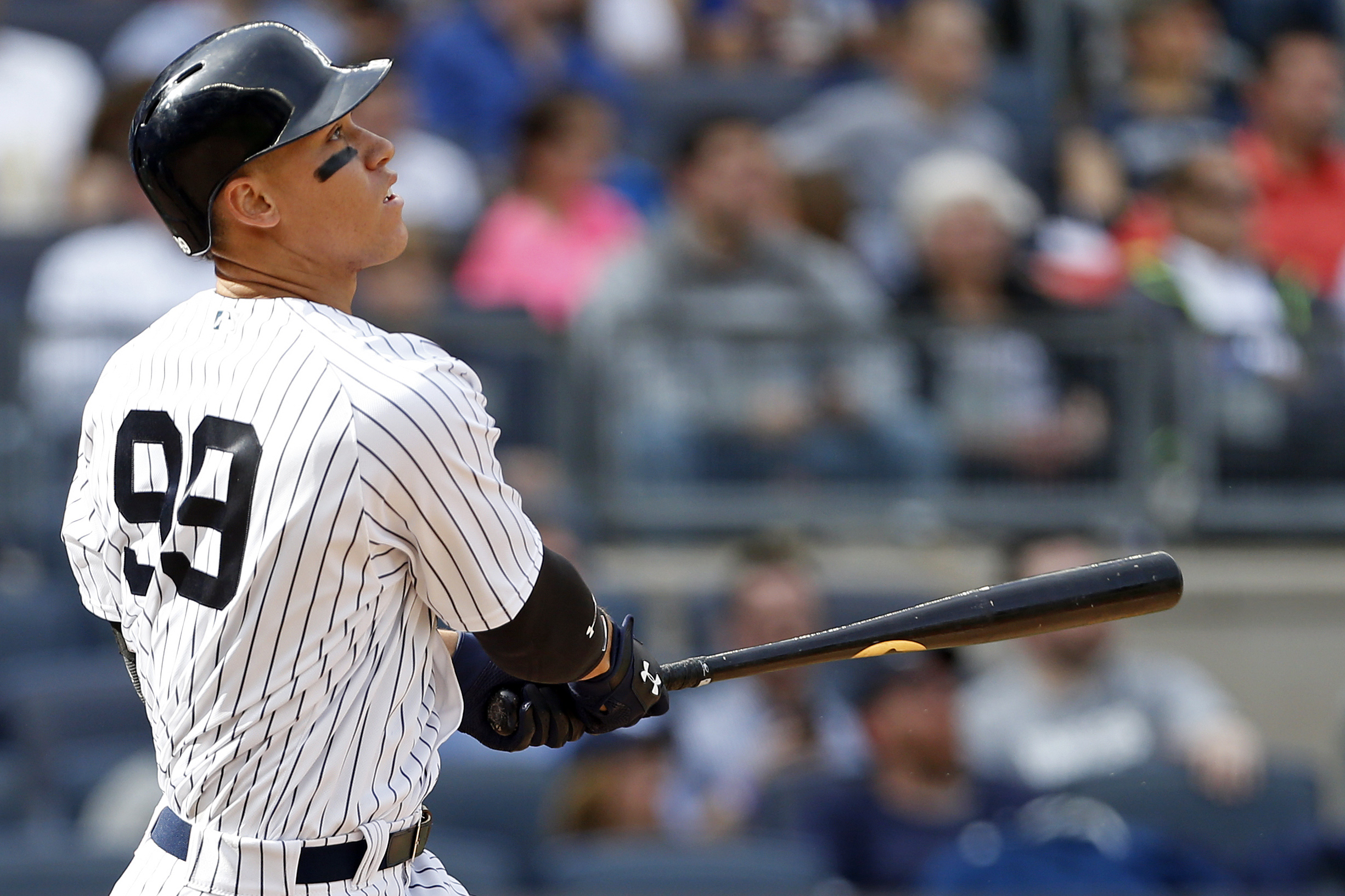 Apr 12, 2017; Bronx, NY, USA; New York Yankees right fielder Aaron Judge (99) watches a two-run home run against the Tampa Bay Rays during the seventh inning at Yankee Stadium. Mandatory Credit: Adam Hunger-USA TODAY Sports