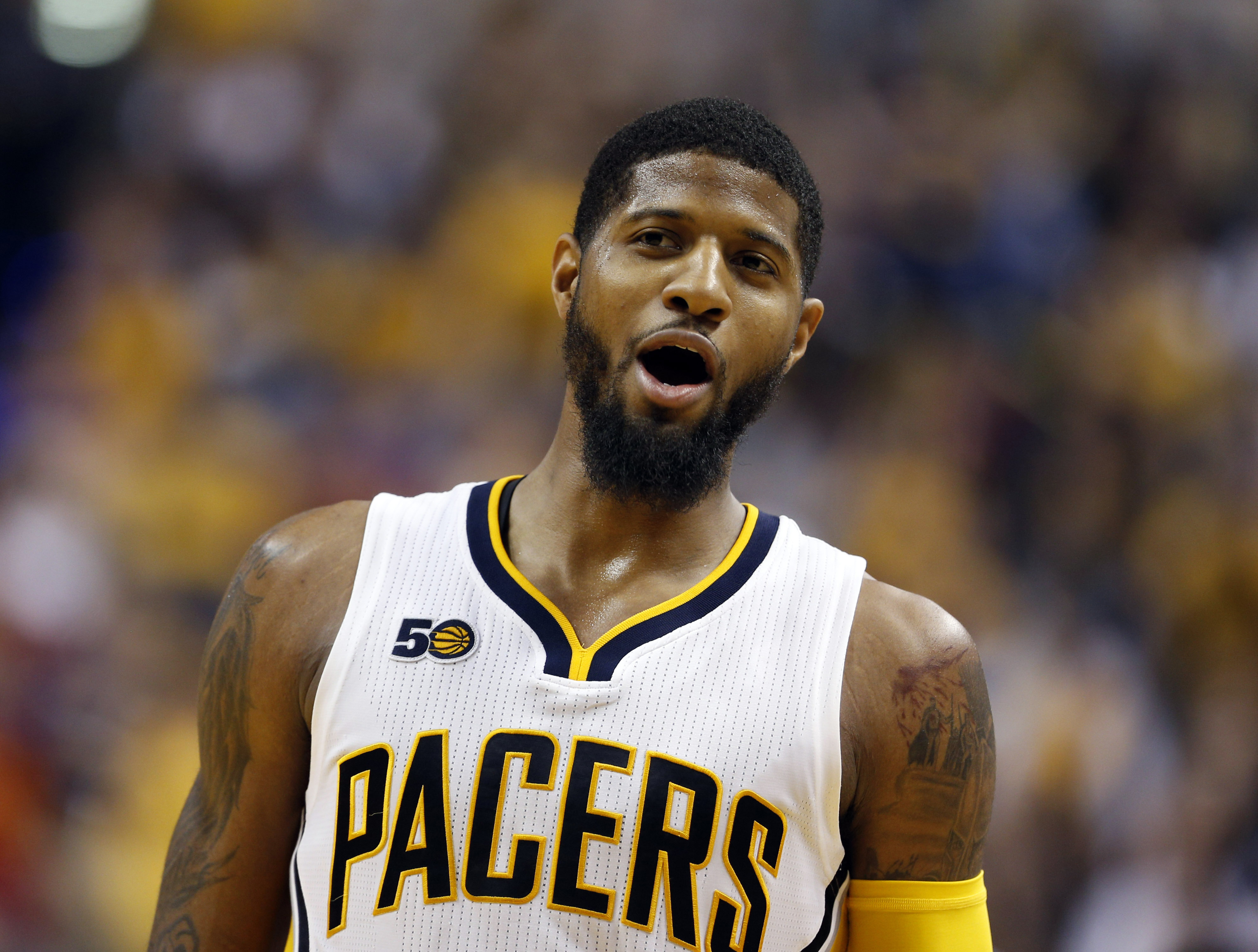Apr 12, 2017; Indianapolis, IN, USA; Indiana Pacers forward Paul George (13) reacts to the Pacers defeating the Atlanta Hawks at Bankers Life Fieldhouse. Indiana defeats Atlanta 104-86. Mandatory Credit: Brian Spurlock-USA TODAY Sports