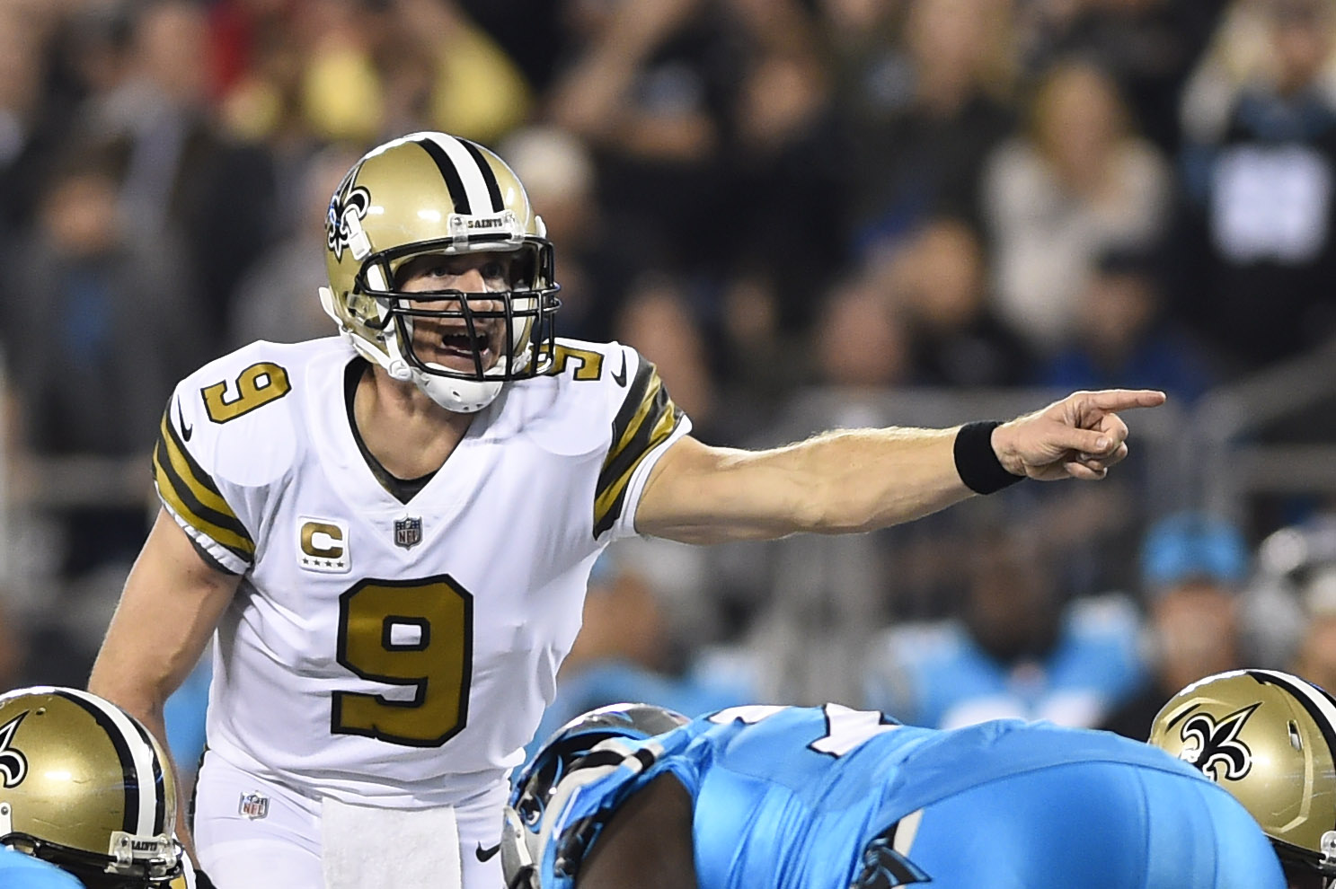 Nov 17, 2016; Charlotte, NC, USA; New Orleans Saints quarterback Drew Brees (9) at the line of scrimmage in the first quarter at Bank of America Stadium. Mandatory Credit: Bob Donnan-USA TODAY Sports