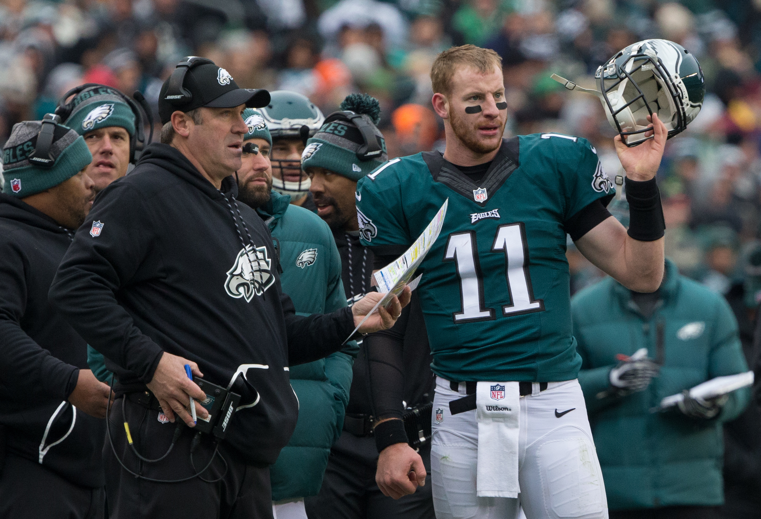 Dec 11, 2016; Philadelphia, PA, USA; Philadelphia Eagles quarterback Carson Wentz (11) talks with head coach Doug Pederson during the second quarter against the Washington Redskins at Lincoln Financial Field. Mandatory Credit: Bill Streicher-USA TODAY Sports