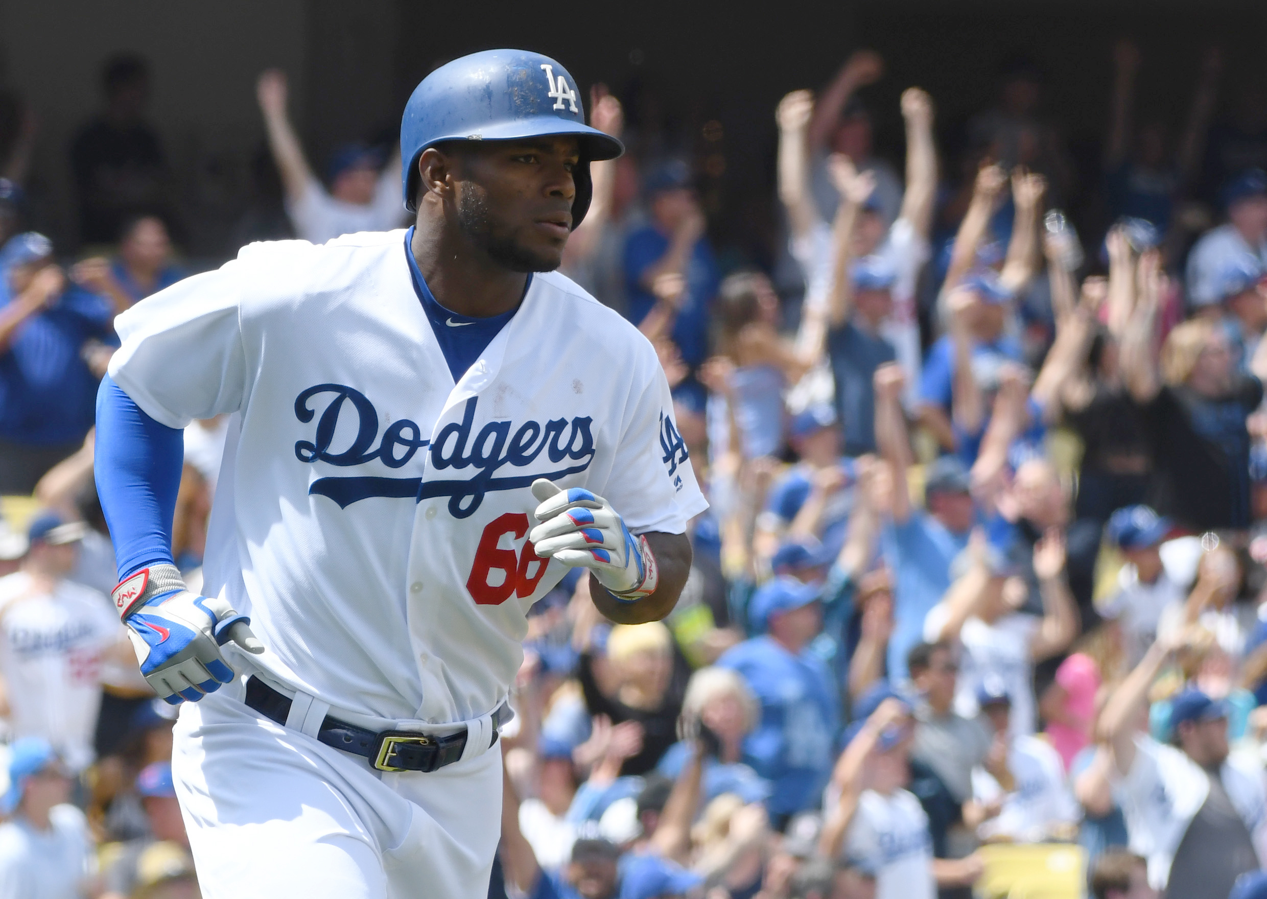 Apr 6, 2017; Los Angeles, CA, USA; Los Angeles Dodgers right fielder Yasiel Puig (66) runs the bases after hitting his second two run home run of the game against the San Diego Padres in the fourth inning at Dodger Stadium. Mandatory Credit: Jayne Kamin-Oncea-USA TODAY Sports