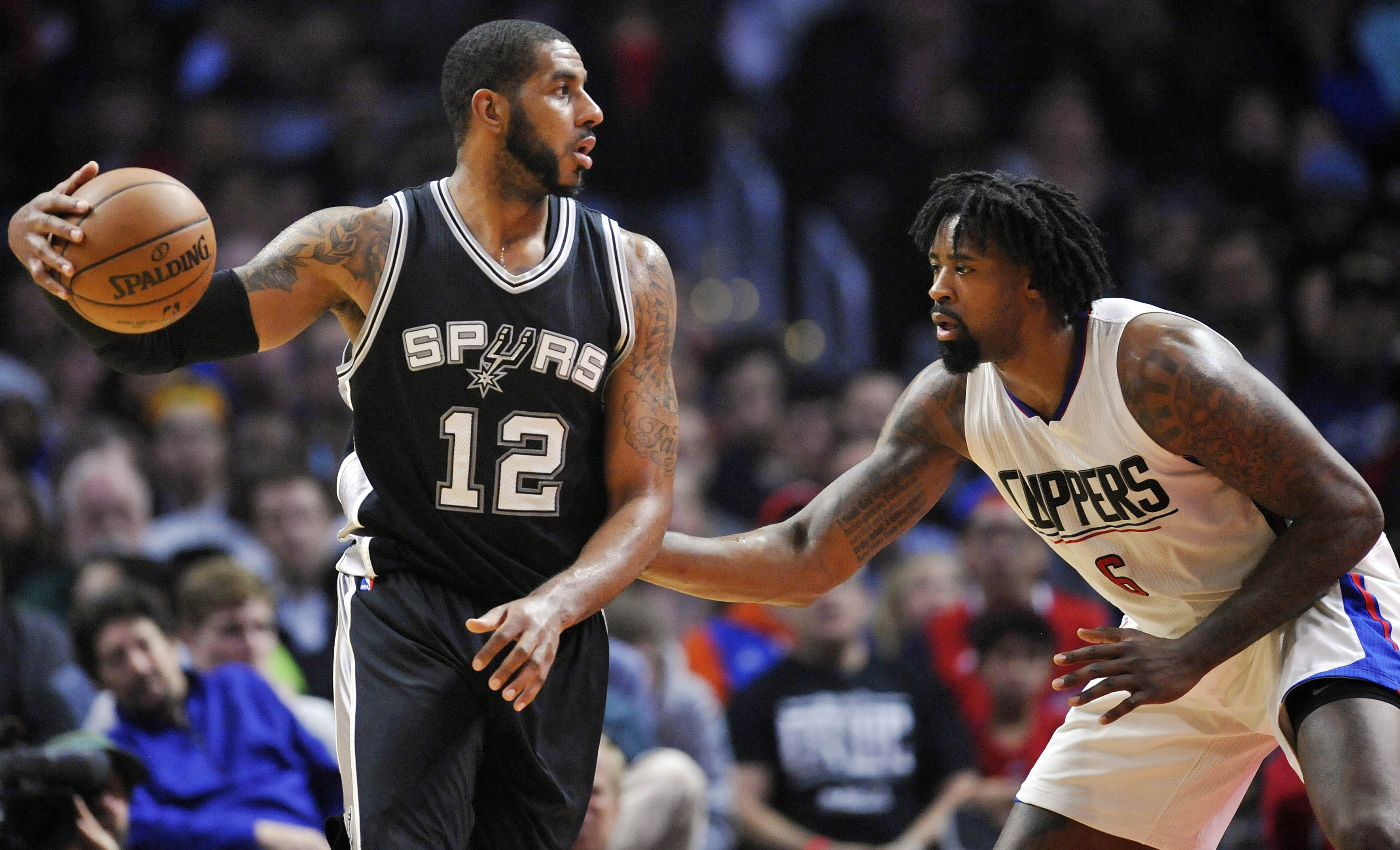 December 22, 2016; Los Angeles, CA, USA; San Antonio Spurs forward LaMarcus Aldridge (12) controls the ball against the defense of Los Angeles Clippers center DeAndre Jordan (6) during the first half  at Staples Center. Mandatory Credit: Gary A. Vasquez-USA TODAY Sports