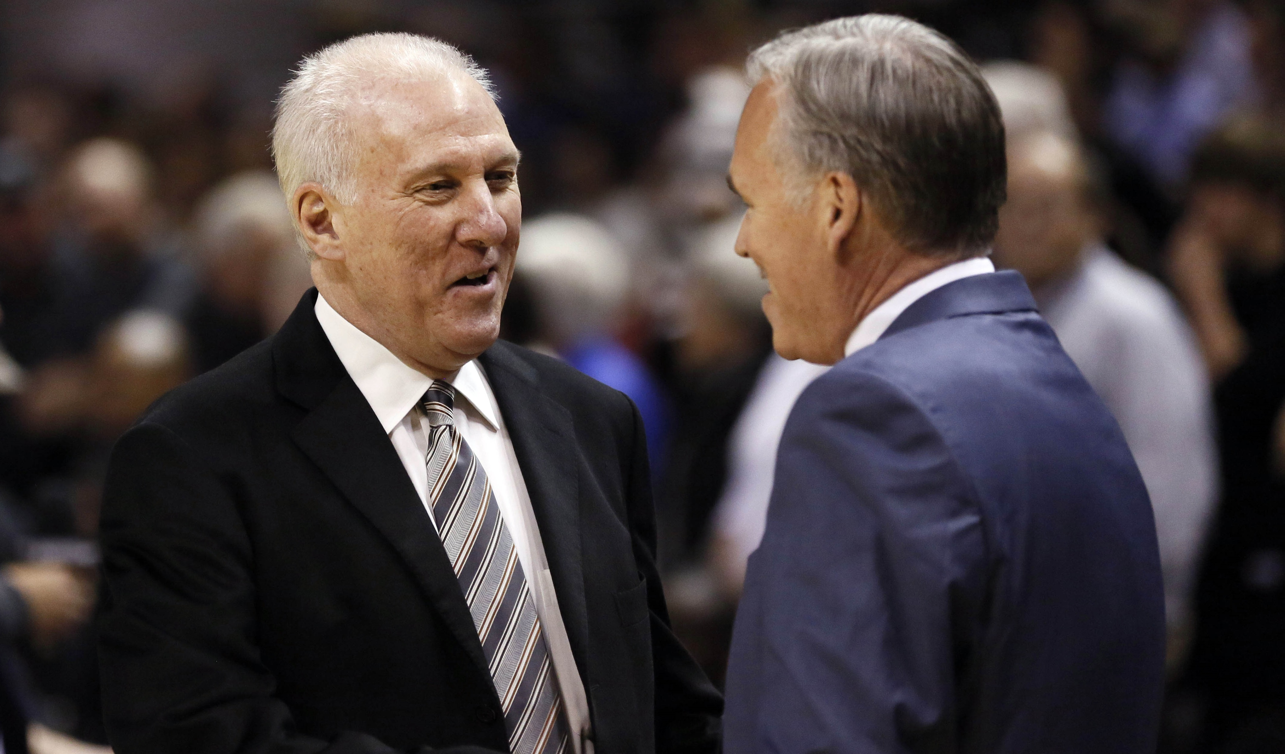 Mar 14, 2014; San Antonio, TX, USA; San Antonio Spurs head coach Gregg Popovich (left) and Los Angeles Lakers head coach Mike D'Antoni (right) greet before the game at AT&T Center. Mandatory Credit: Soobum Im-USA TODAY Sports