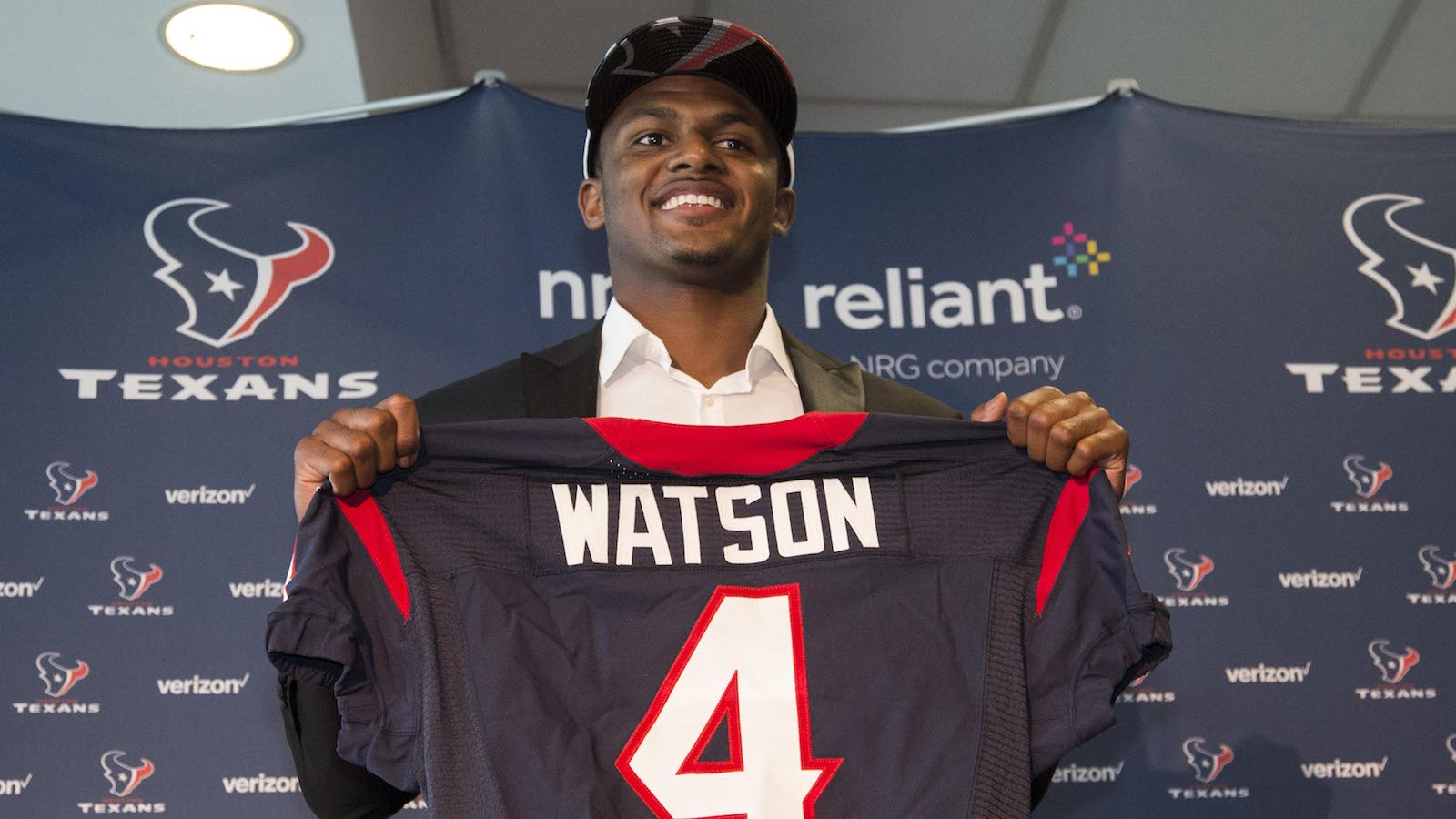 Apr 28, 2017; Houston, TX, USA; Houston Texans first round draft pick Deshaun Watson poses with a jersey during a press conference at NRG Stadium. Mandatory Credit: Troy Taormina-USA TODAY Sports