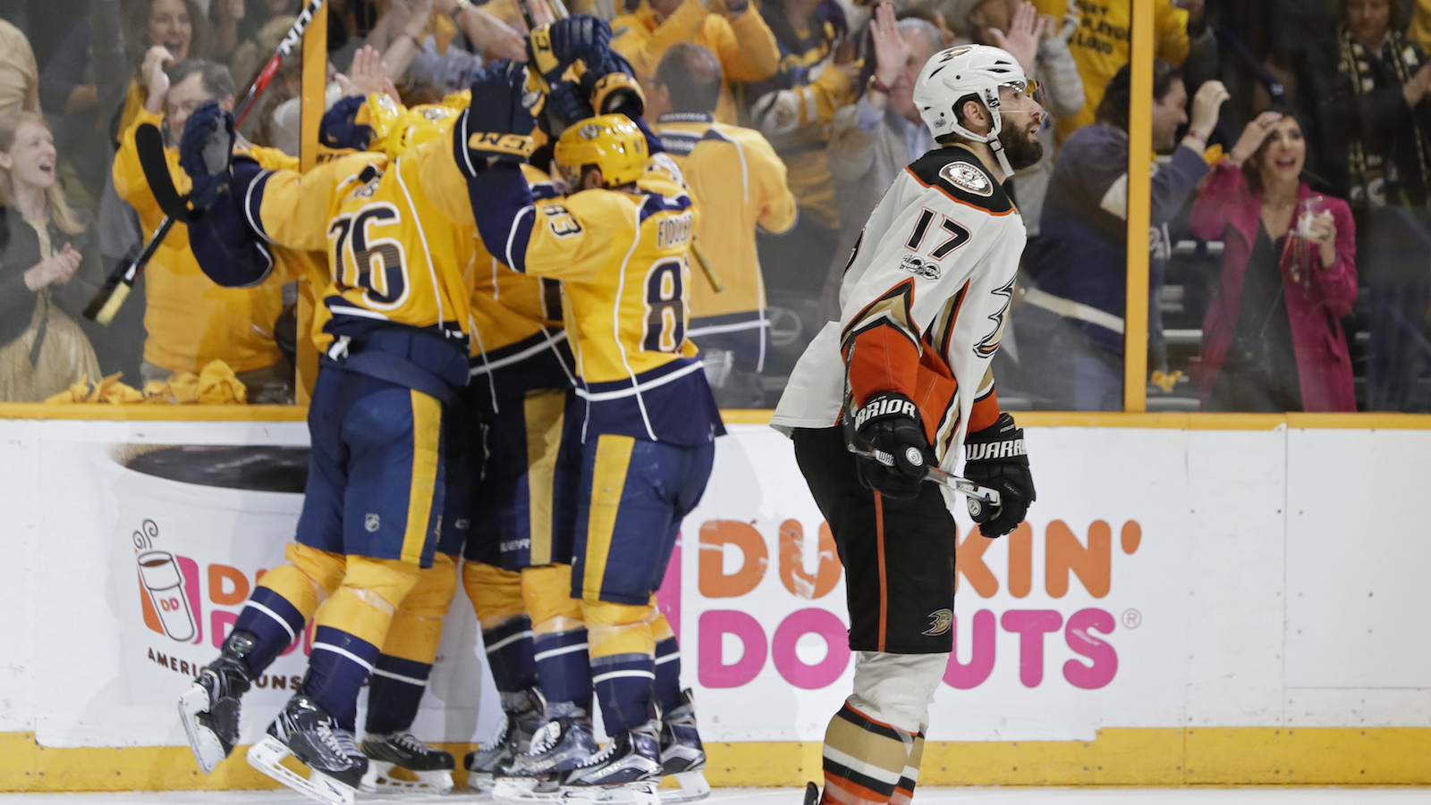 Anaheim Ducks center Ryan Kesler (17) skates past as Nashville Predators players celebrate an empty-net goal during the third period in Game 6 of the Western Conference final in the NHL hockey Stanley Cup playoffs Monday, May 22, 2017, in Nashville, Tenn. (AP Photo/Mark Humphrey)