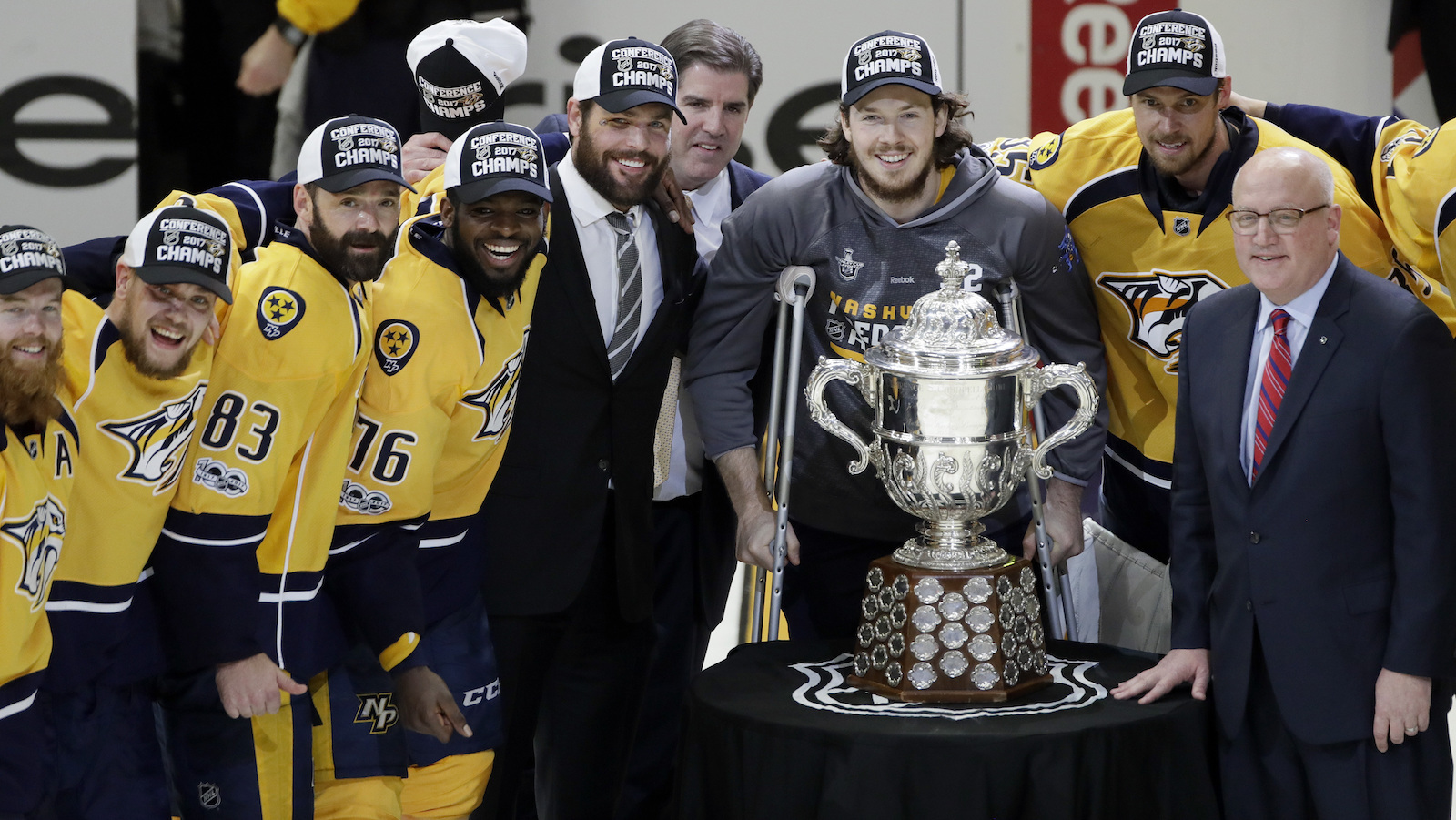 NHL Deputy Commissioner Bill Daly, right, presents the Clarence S. Campbell Bowl to the Nashville Predators after the Predators beat the Anaheim Ducks in Game 6 of the Western Conference final in the NHL hockey Stanley Cup playoffs Monday, May 22, 2017, in Nashville, Tenn. The Predators won 6-3 to win the series 4-2 and advance to the Stanley Cup Finals. (AP Photo/Mark Humphrey)
