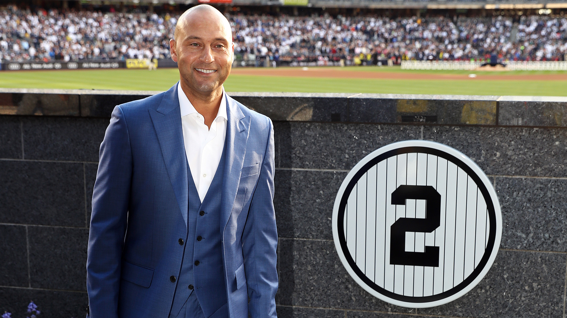 May 14, 2017; Bronx, NY, USA; Former New York Yankees shortstop Derek Jeter poses with his retired jersey number during a ceremony before the game against the Houston Astros at Yankee Stadium. Mandatory Credit: Elsa/Pool Photo via USA TODAY Sports