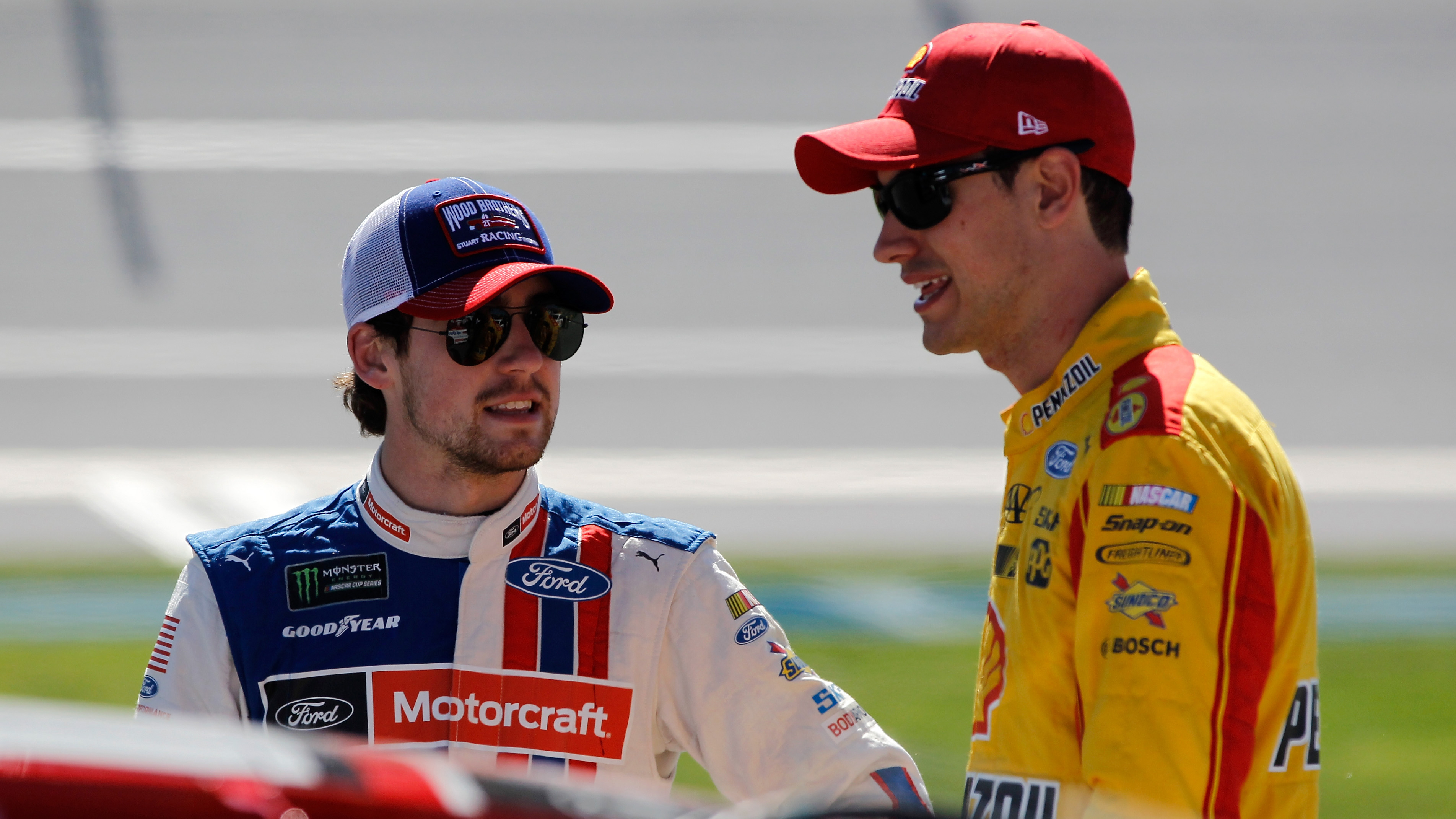 TALLADEGA, AL - MAY 06:  Ryan Blaney, driver of the #21 Motorcraft/Quick Lane Tire & Auto Center Ford, talks to Joey Logano, driver of the #22 Shell Pennzoil Ford, on the grid during qualifying for the Monster Energy NASCAR Cup Series GEICO 500 at Talladega Superspeedway on May 6, 2017 in Talladega, Alabama.  (Photo by Brian Lawdermilk/Getty Images)
