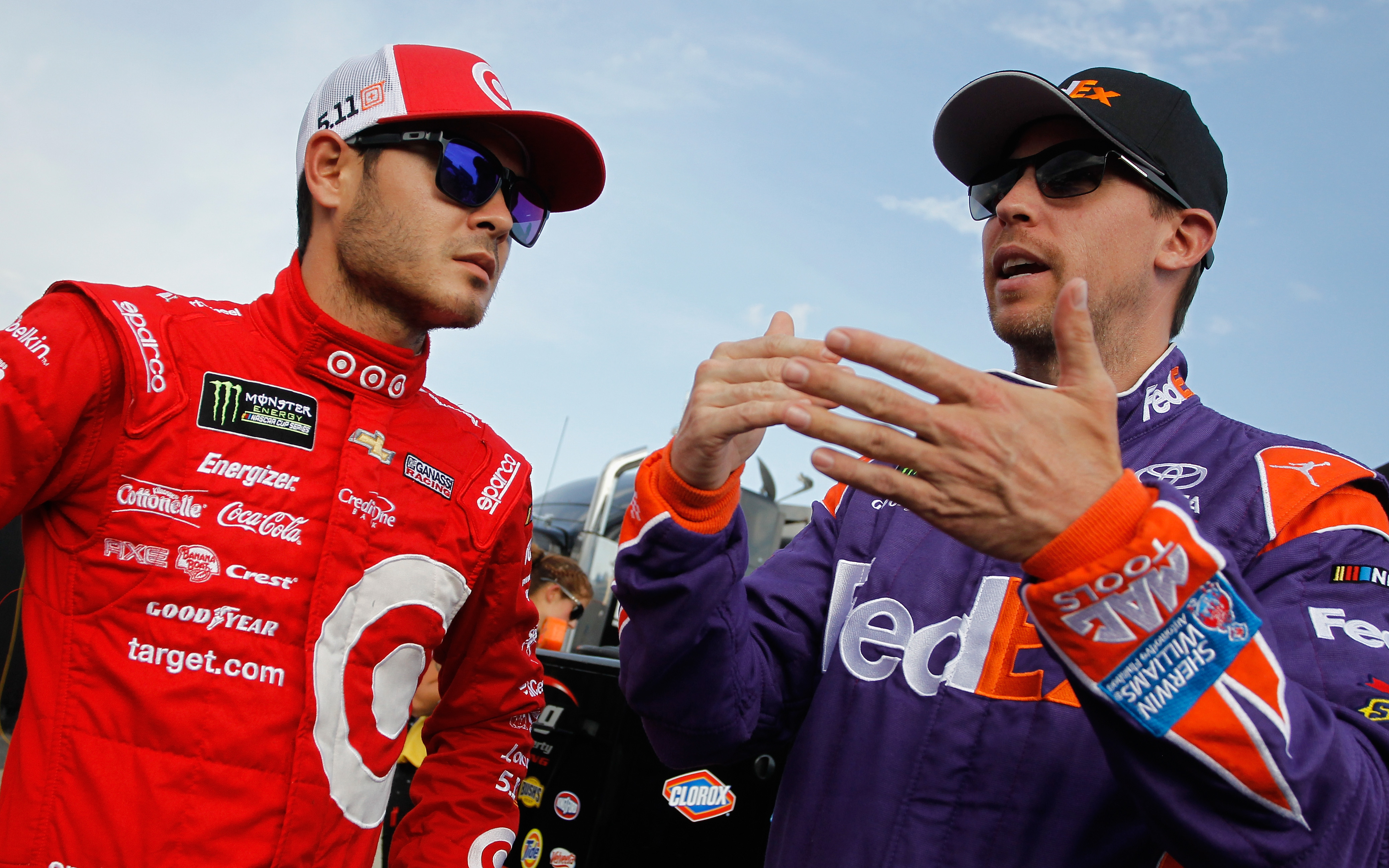 CHARLOTTE, NC - MAY 19:  Kyle Larson, driver of the #42 Target Chevrolet, talks with Denny Hamlin, driver of the #11 FedEx Ground Toyota, during qualifying for the Monster Energy NASCAR All-Star Race at Charlotte Motor Speedway on May 19, 2017 in Charlotte, North Carolina.  (Photo by Brian Lawdermilk/Getty Images)