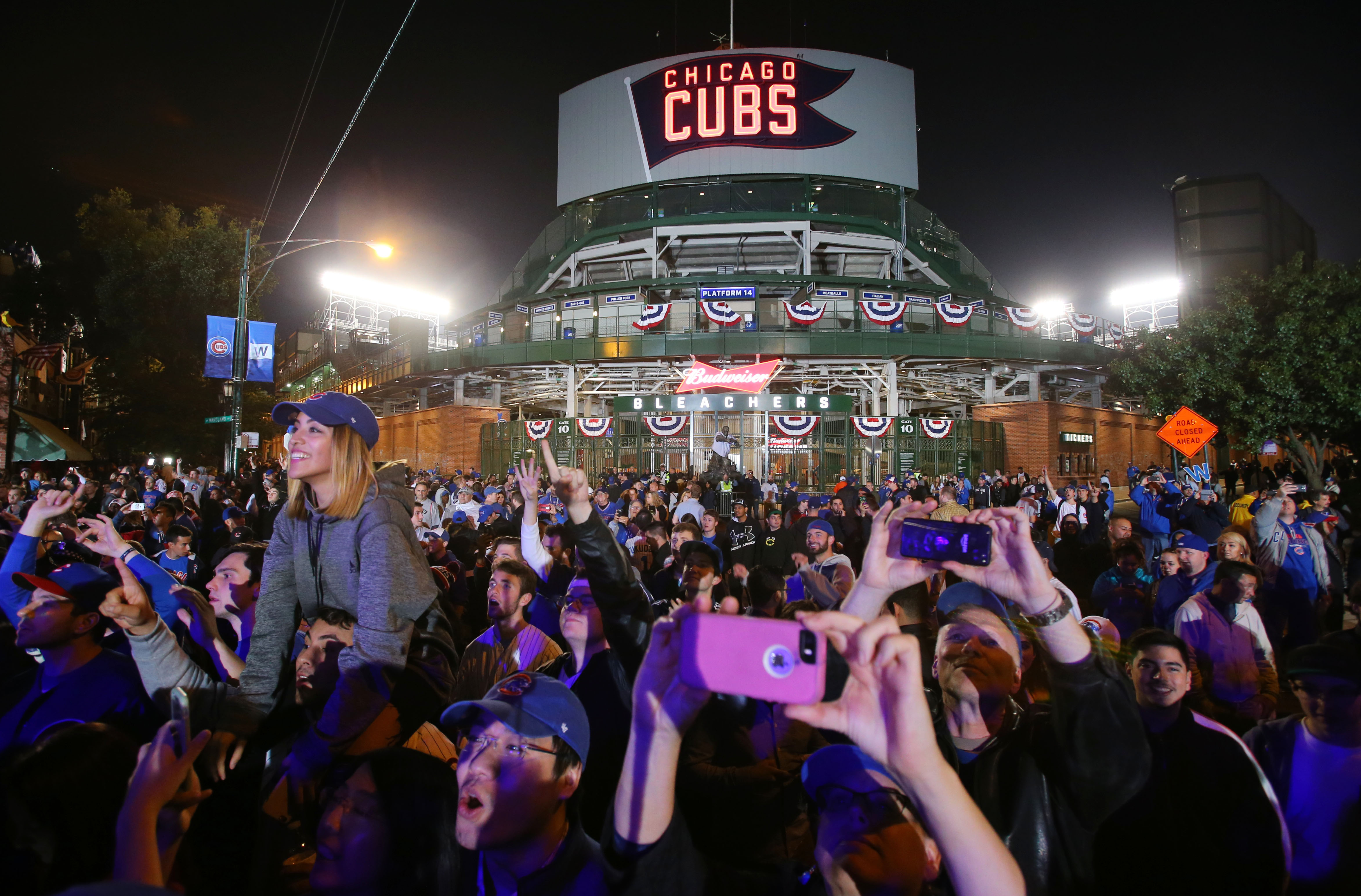 Oct 22, 2016; Chicago, IL, USA; Chicago Cubs fans celebrate outside of the bleachers entrance after game six of the 2016 NLCS playoff baseball series between the Cubs and Los Angeles Dodgers at Wrigley Field. Mandatory Credit: Jerry Lai-USA TODAY Sports