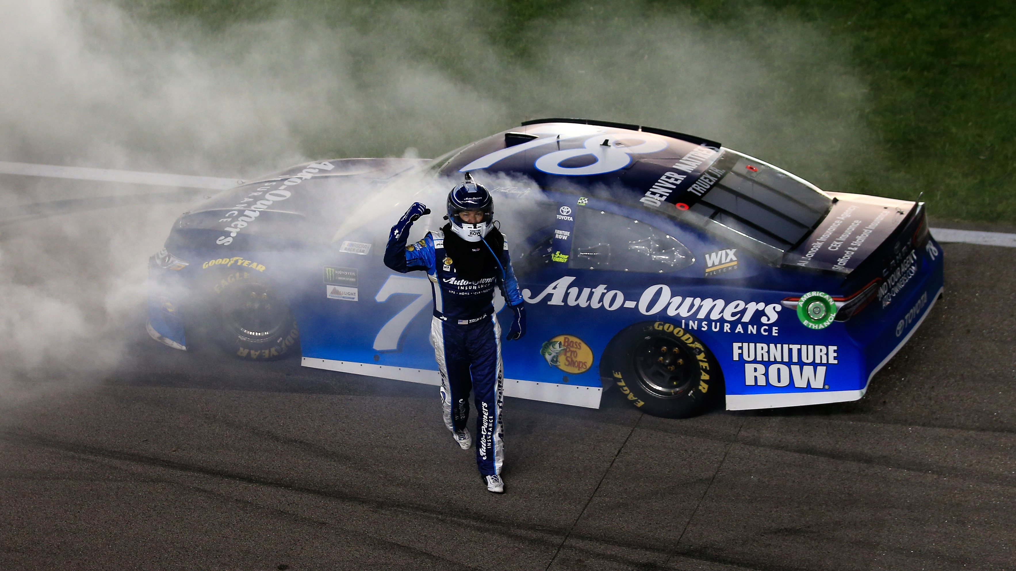 KANSAS CITY, KS - MAY 13:  Martin Truex Jr., driver of the #78 Auto-Owners Insurance Toyota, celebrates with a burnout after winning the Monster Energy NASCAR Cup Series Go Bowling 400 at Kansas Speedway on May 13, 2017 in Kansas City, Kansas.  (Photo by Chris Trotman/Getty Images)