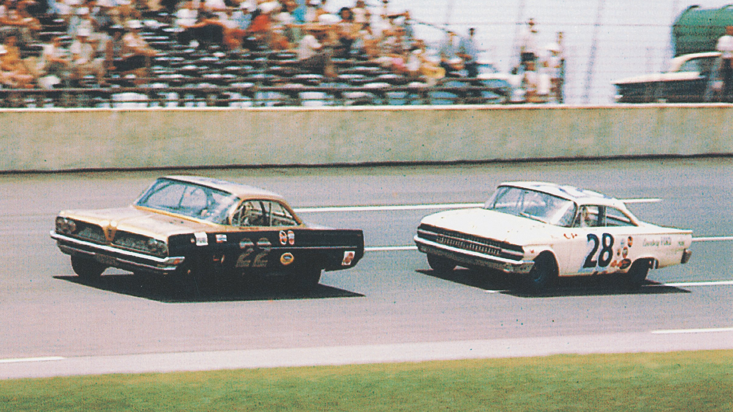 """DAYTONA BEACH, FL - FEBRUARY 18: Glenn """"Fireball"""" Roberts driver of the #22 Ponticac leads Fred Lorenzen driver of the #28 Ford during the 1962 NASCAR Winston Cup Daytona 500 at the Daytona International Speedway on February 18, 1962 in Daytona Beach, Florida. Fireball Roberts would go on to win the Daytona 500. (Photo by ISC Archives via Getty Images)"""