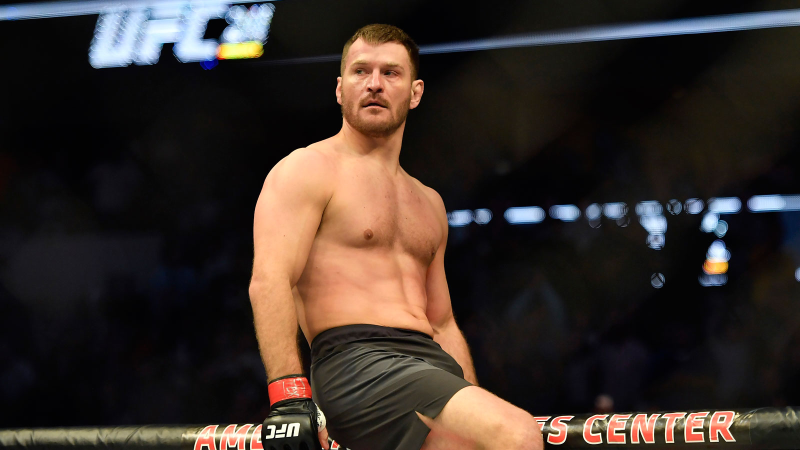 May 13, 2017; Dallas, TX, USA; Stipe Miocic (red gloves) looks on to the octagon after he defeats Junior Dos Santos (blue gloves) during UFC 211 at American Airlines Center. Mandatory Credit: Jerome Miron-USA TODAY Sports