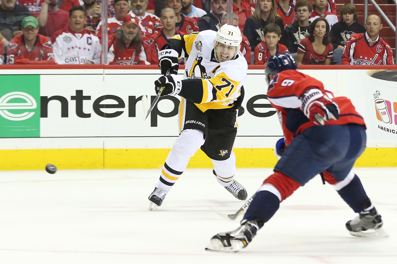 Apr 29, 2017; Washington, DC, USA; Pittsburgh Penguins center Evgeni Malkin (71) shoots the puck past Washington Capitals defenseman Dmitry Orlov (9) during the second period in game two of the second round of the 2017 Stanley Cup Playoffs at Verizon Center. Mandatory Credit: Geoff Burke-USA TODAY Sports