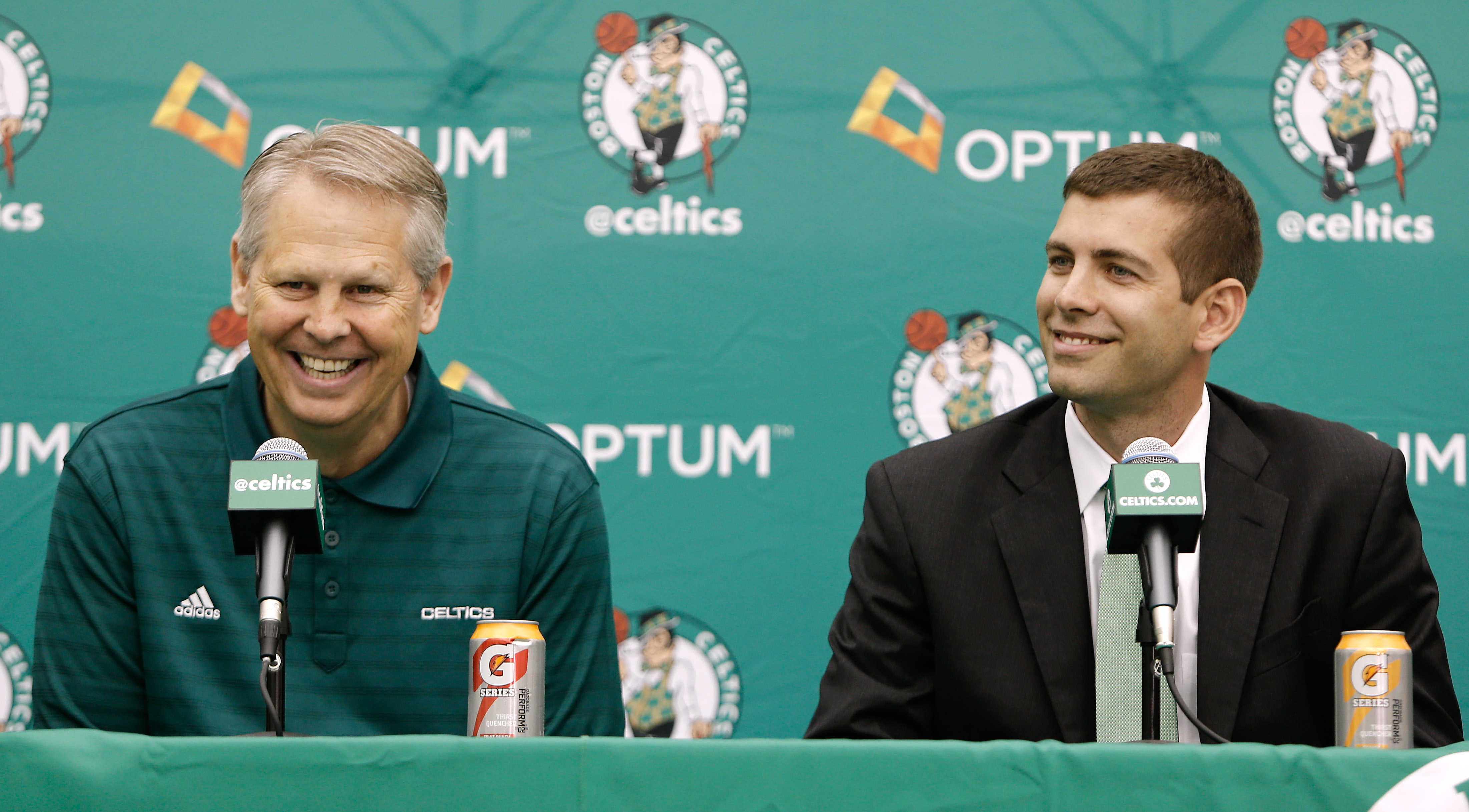 Jul 5, 2013; Waltham, MA, USA; New Boston Celtics head coach Brad Stevens, right, shares a laugh with General Manager Danny Ainge during a news conference announcing Stevens new position. Mandatory Credit: Winslow Townson-USA TODAY Sports