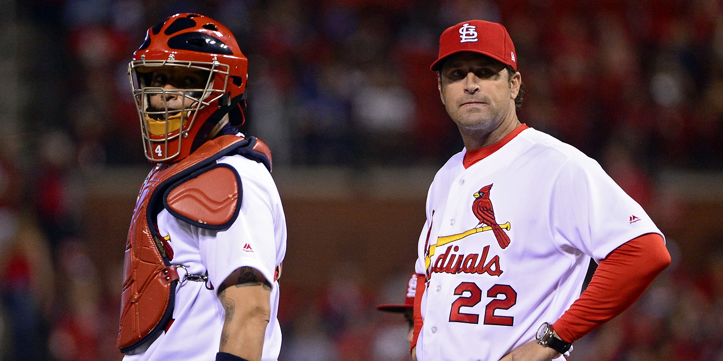 Apr 18, 2017; St. Louis, MO, USA; St. Louis Cardinals catcher Yadier Molina (4) and manager Mike Matheny (22) look on after removing starting pitcher Mike Leake (not pictured) from the game during the seventh inning against the Pittsburgh Pirates at Busch Stadium. The Cardinals won 2-1. Mandatory Credit: Jeff Curry-USA TODAY Sports