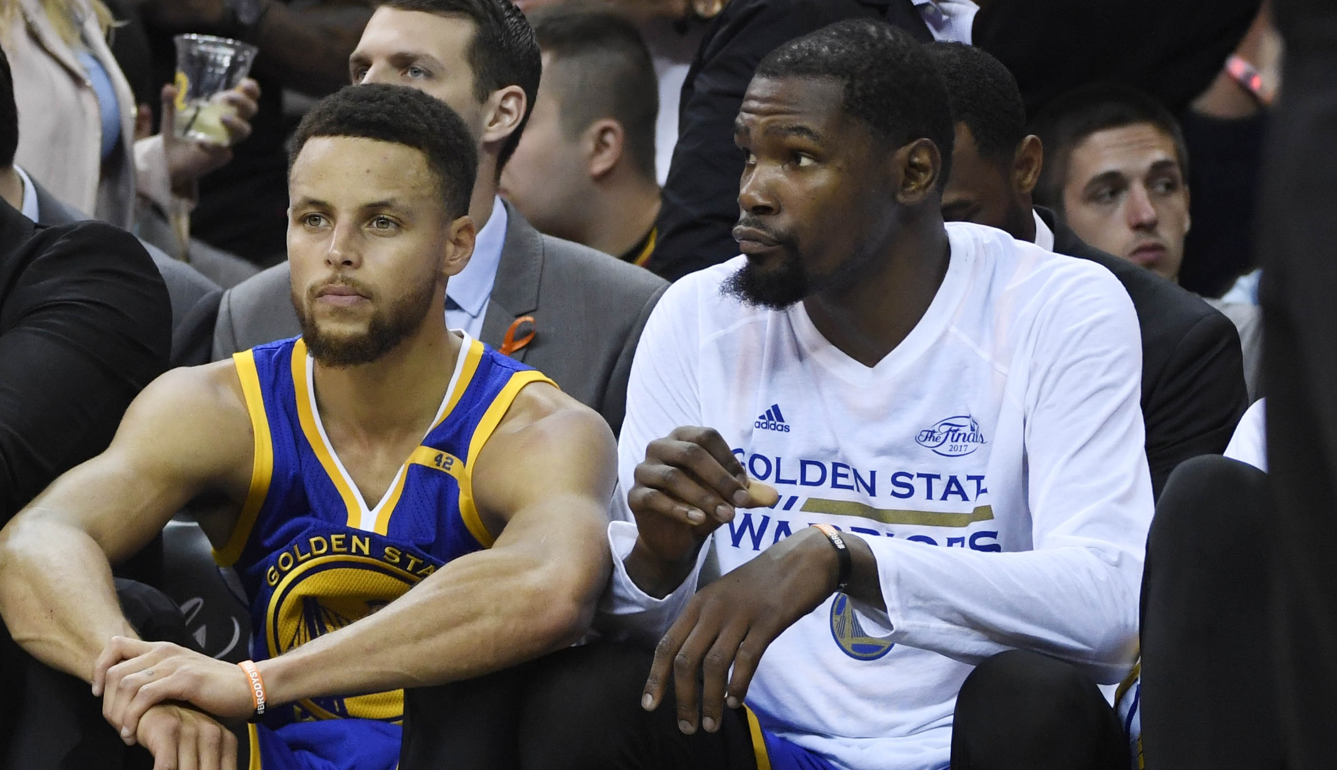 Jun 9, 2017; Cleveland, OH, USA; Golden State Warriors guard Stephen Curry (30) and forward Kevin Durant (right) on the bench against the Cleveland Cavaliers during the first half in game four of the 2017 NBA Finals at Quicken Loans Arena. Mandatory Credit: Kyle Terada-USA TODAY Sports