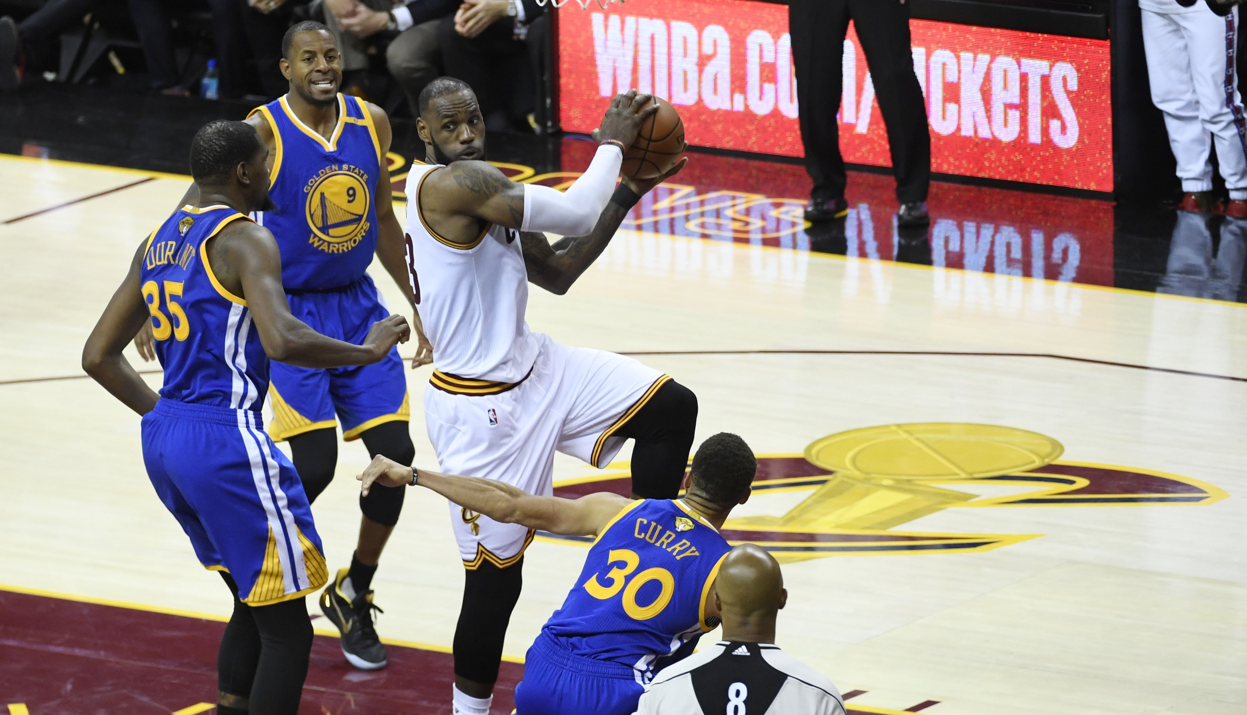 Jun 9, 2017; Cleveland, OH, USA; Cleveland Cavaliers forward LeBron James (23) drives to the basket against Golden State Warriors forward Kevin Durant (35) and guard Stephen Curry (30) during the second half in game four of the 2017 NBA Finals at Quicken Loans Arena. Mandatory Credit: Kyle Terada-USA TODAY Sports