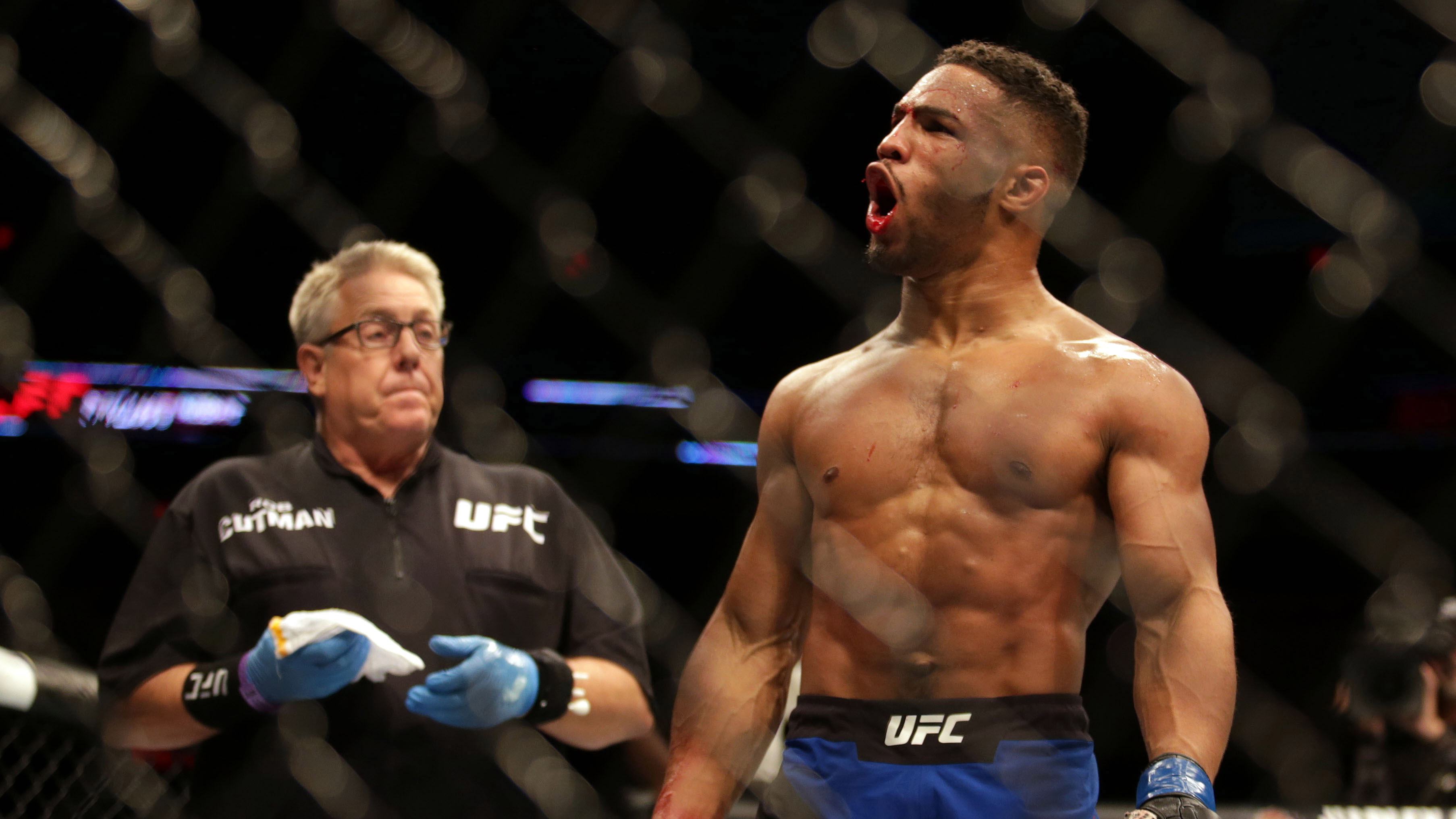 Jun 25, 2017; Oklahoma City, OK, USA; Kevin Lee (blue gloves) reacts after beating Michael Chiesa (red gloves) during UFC Fight Night at Chesapeake Energy Arena. Mandatory Credit: Sean Pokorny-USA TODAY Sports