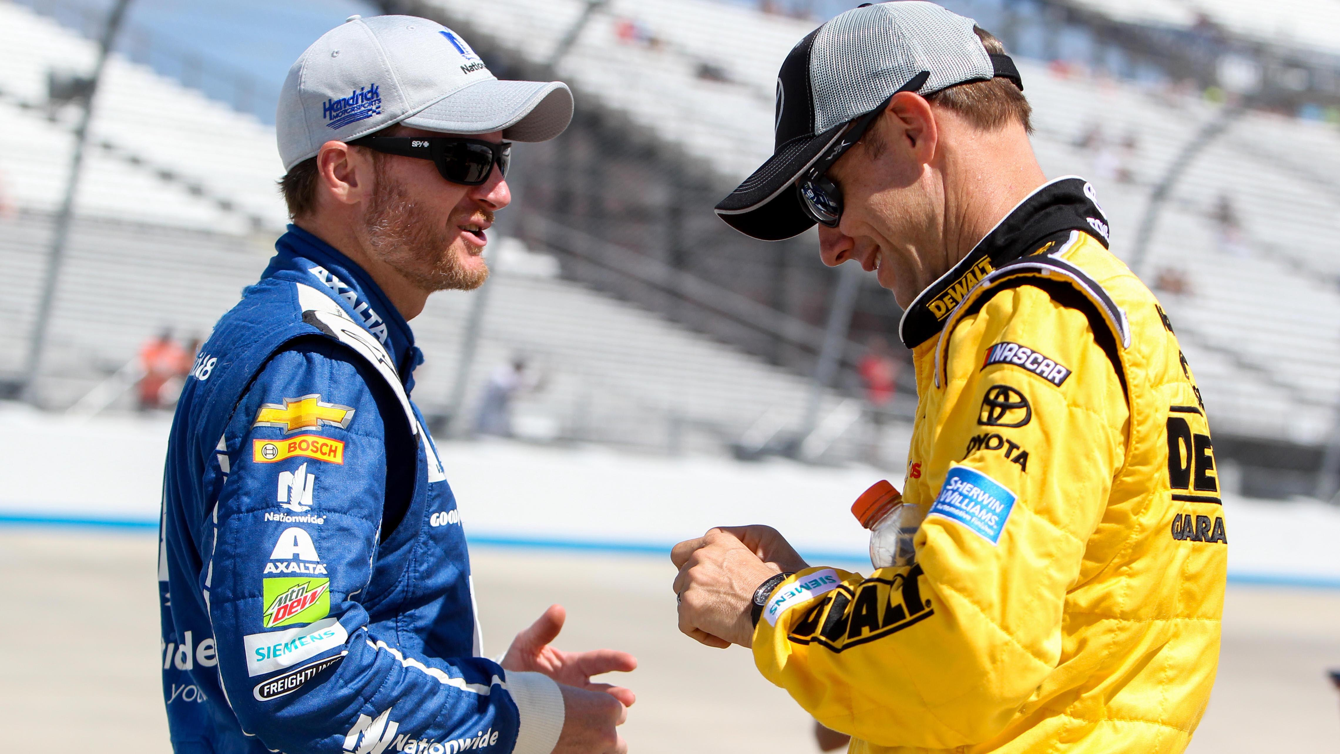 Jun 2, 2017; Dover, DE, USA; NASCAR Cup Series driver Dale Earnhardt Jr (left) and driver Matt Kenseth (right) talk on pit road during the qualifying for the AAA 400 Drive For Autism at Dover International Speedway. Mandatory Credit: Matthew O'Haren-USA TODAY Sports