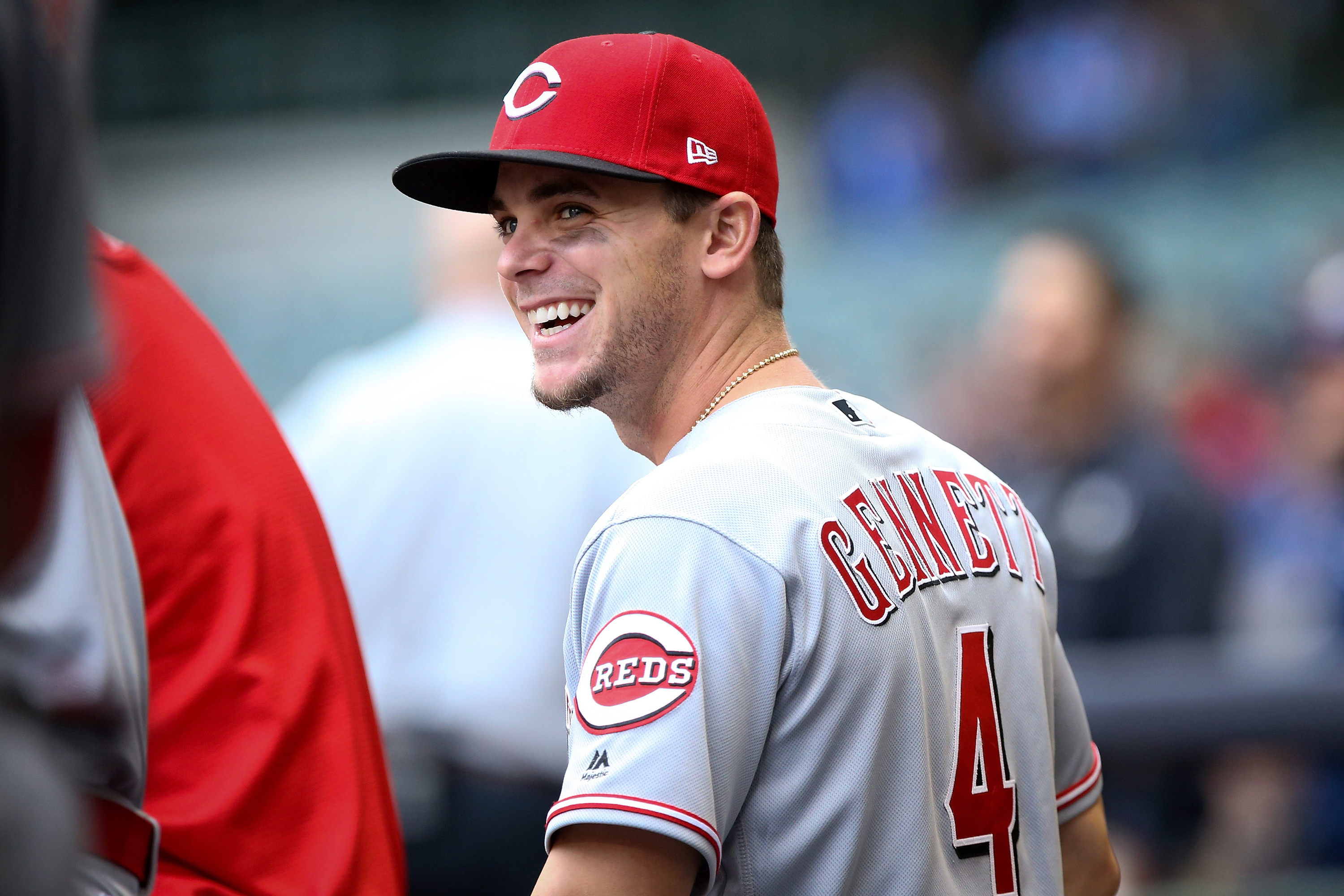 MILWAUKEE, WI - APRIL 25:  Scooter Gennett #4 of the Cincinnati Reds walks through the dugout before the game against the Milwaukee Brewers at Miller Park on April 25, 2017 in Milwaukee, Wisconsin. (Photo by Dylan Buell/Getty Images)