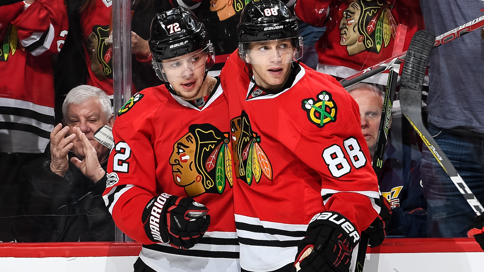 CHICAGO, IL - MARCH 31:  Artemi Panarin #72 and Patrick Kane #88 of the Chicago Blackhawks celebrate after Panarin scored an empty-net goal against the Columbus Blue Jackets in the third period at the United Center on March 31, 2017 in Chicago, Illinois.  (Photo by Bill Smith/NHLI via Getty Images)