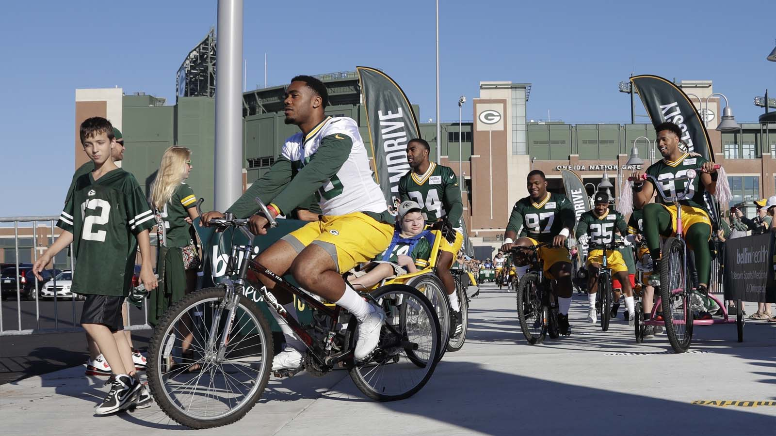 Green Bay Packers players ride bikes to training camp at Ray Nitschke Field in Ashwabenon, Wis., on Thursday, July 27, 2017.